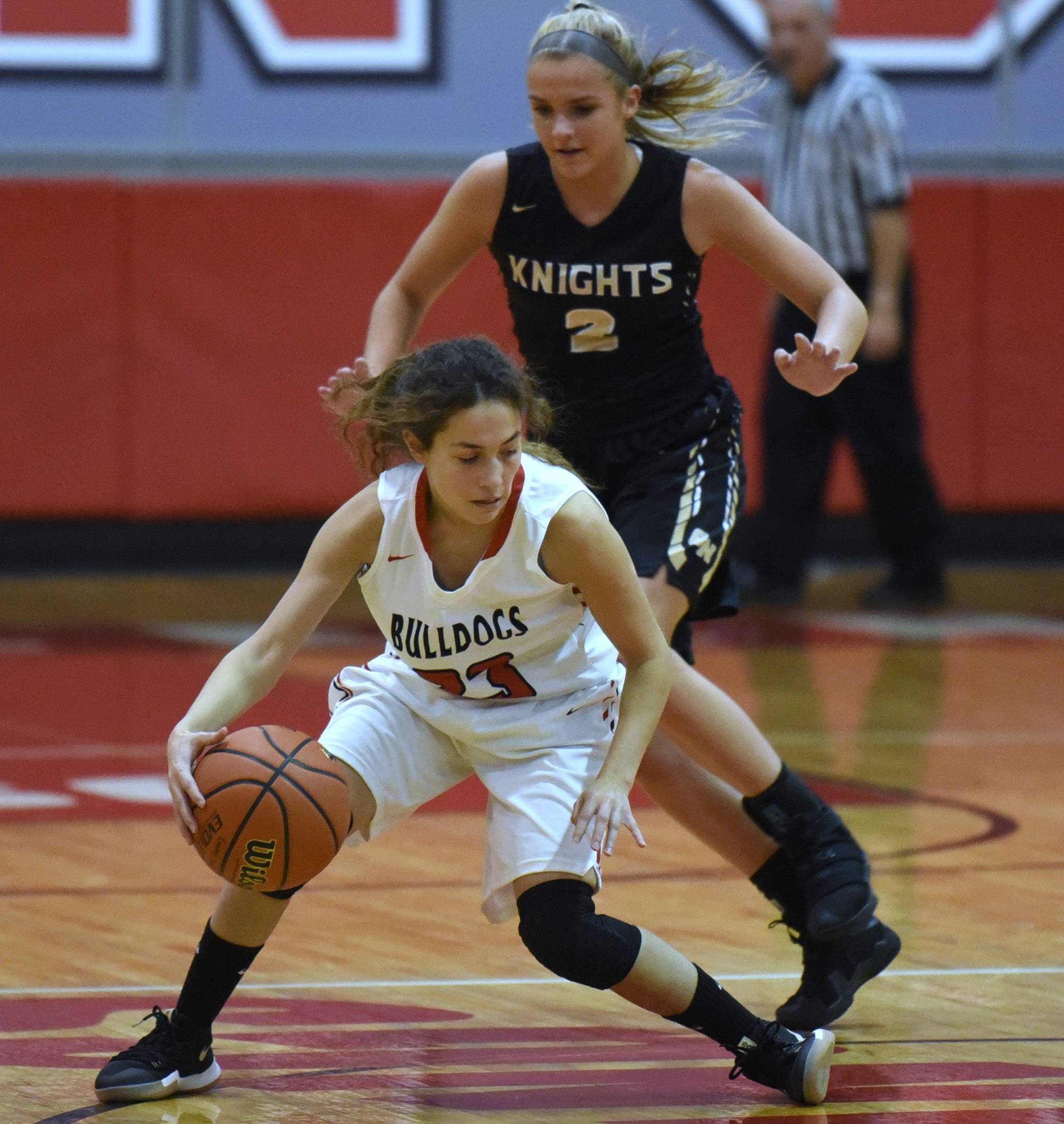 Grant's Mercedes Uribe tries to get past Grayslake North's Jordyn Gerdes (2) Monday at Mundelein's Thanksgiving tournament.