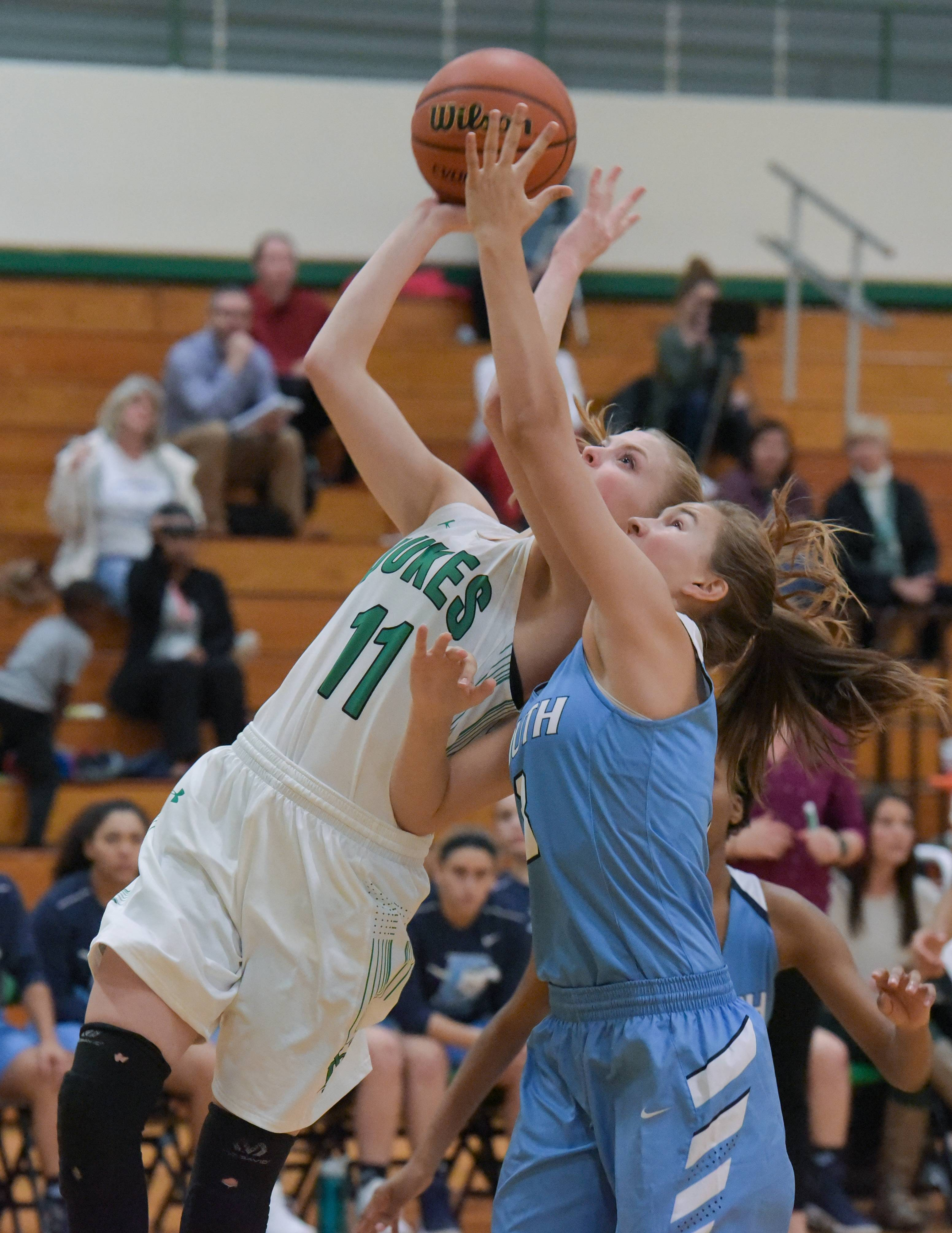 York's Danielle Dennis (11) takes a shot after getting past  Downers Grove South's Meghan Stapleton (3) during the York High School Thanksgiving girls basketball tournament on November 14, 2017.