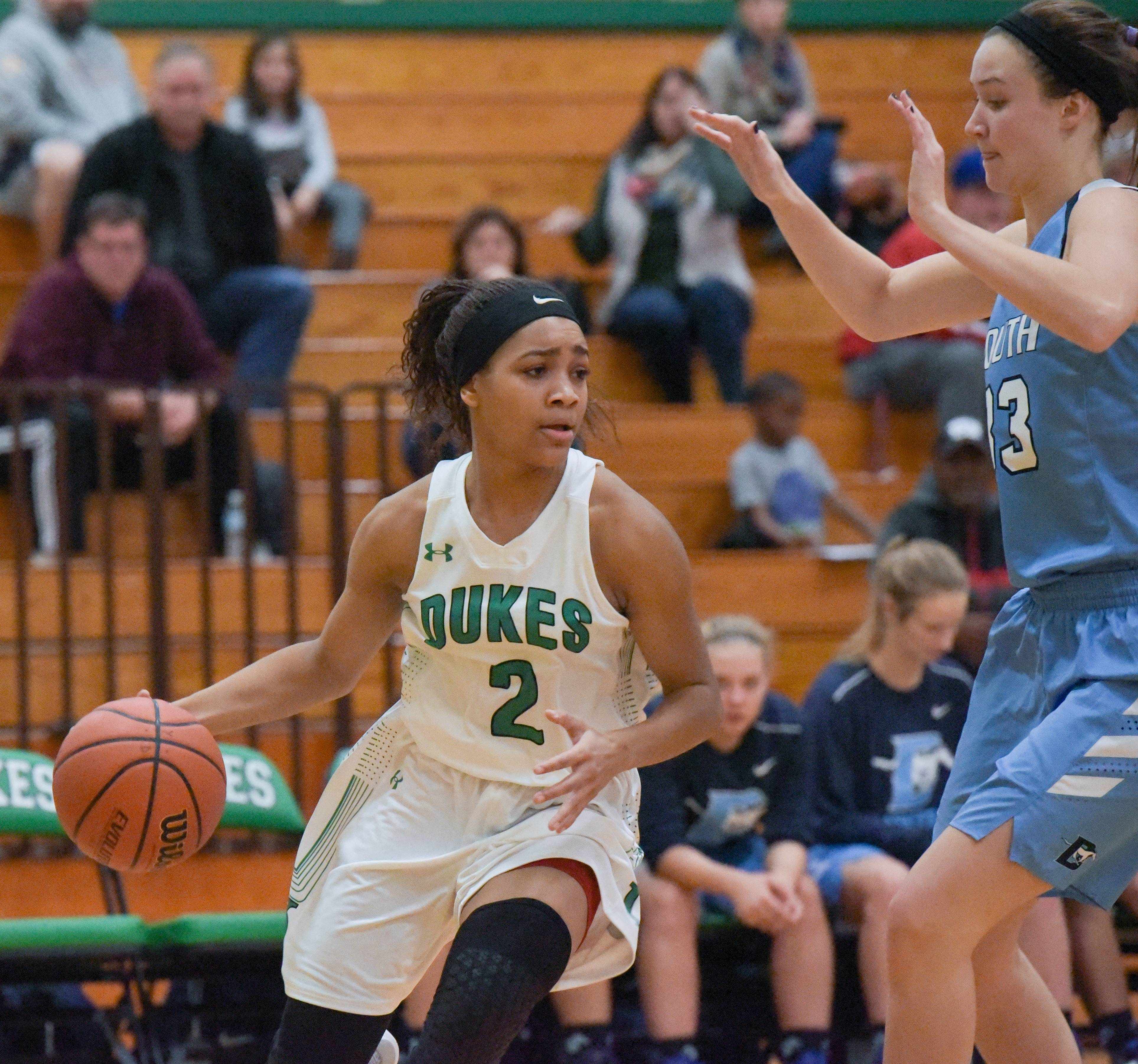 York's Kiah Rufus (2) drives around Downers Grove South's Holly Lueken (33) during the York High School Thanksgiving girls basketball tournament on November 14, 2017.