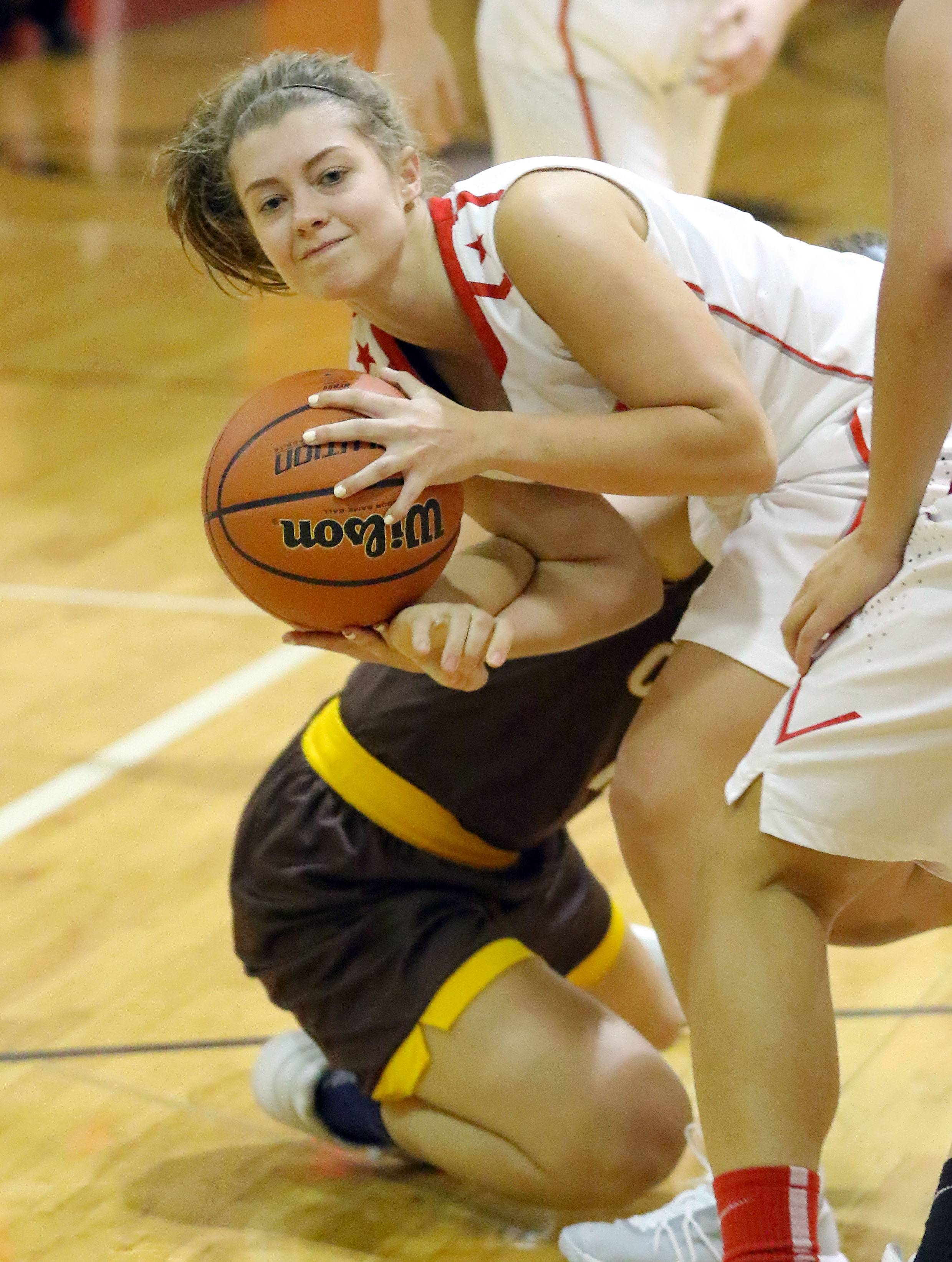 Mundelein's Kelsey Austwick looks to pass against Carmel on Tuesday at Mundelein.