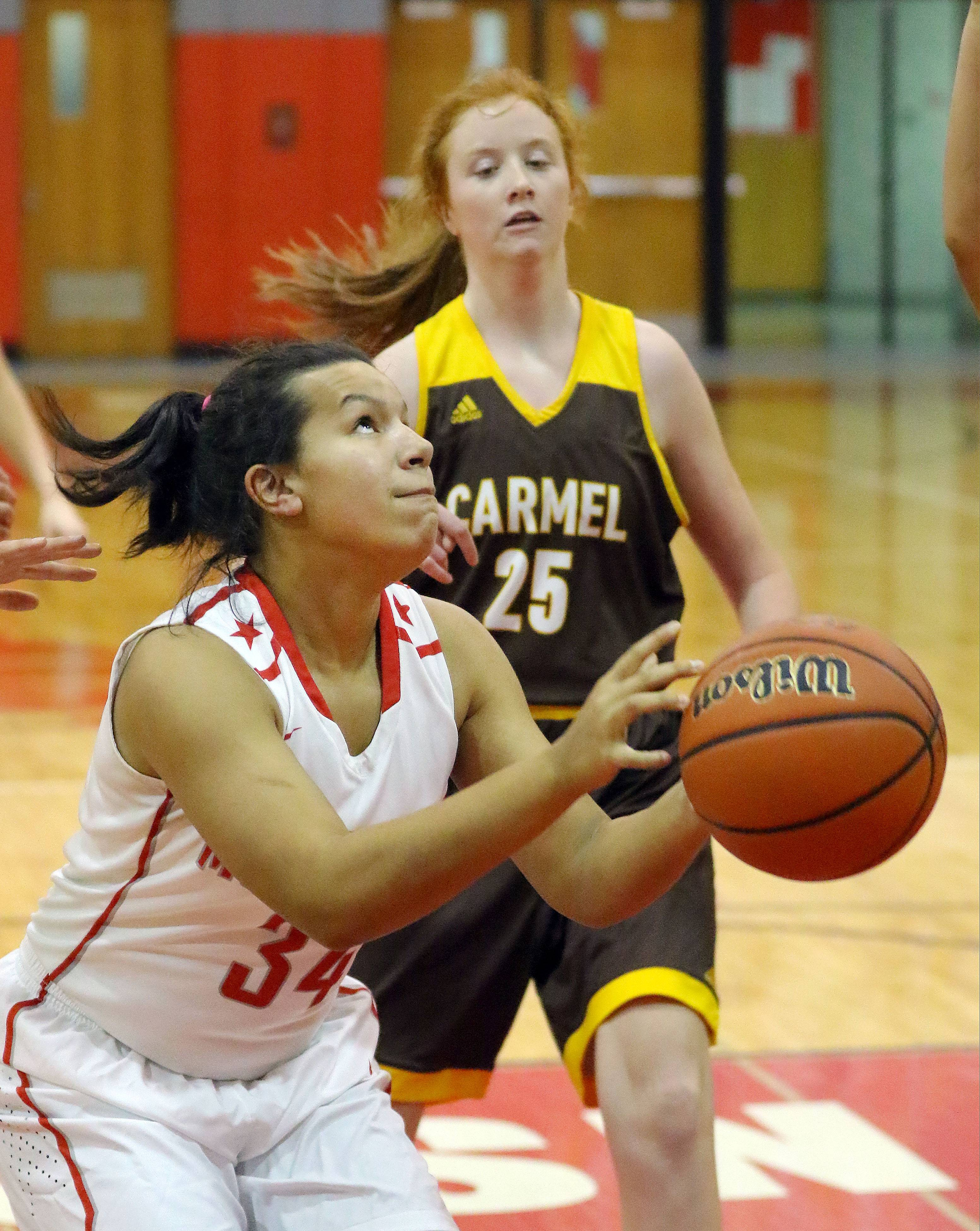 Mundelein's Kendall Klatt, left, looks to shoot as Carmel's Brigit Barr pursues on Tuesday at Mundelein.
