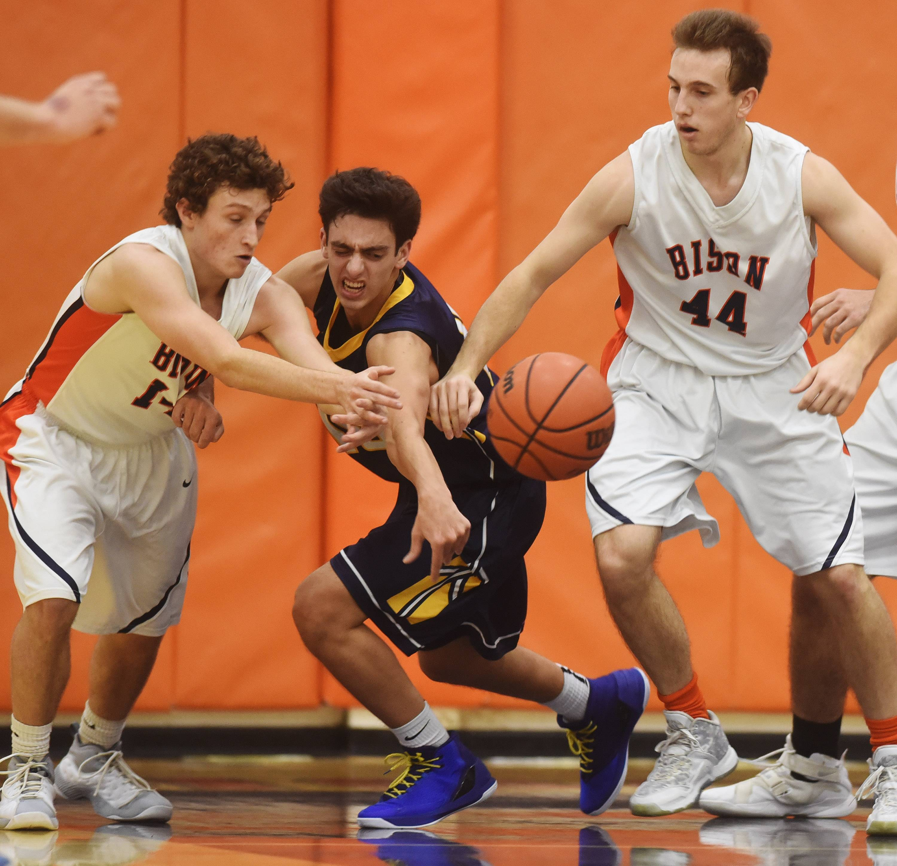 Buffalo Grove's Kyle Adams, left, and Jack Vaselaney, here bracketing Glenbrook South's George Arvanistis during tourney play at BG last year, are among the reasons the Bison have high hopes for this season.