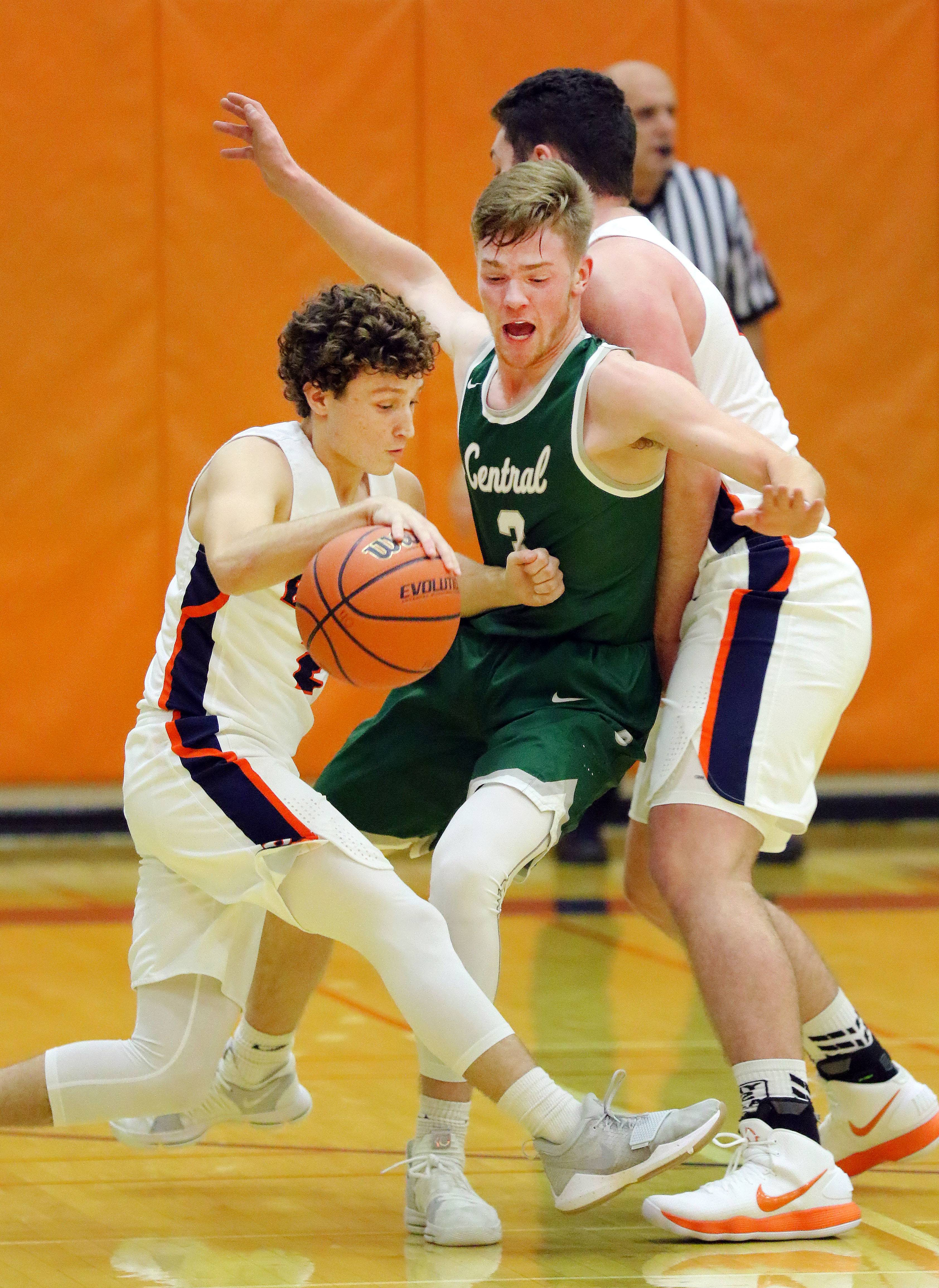 Buffalo Grove's Kyle Adams, left, drives on Grayslake Central's Alec Novak on Monday night at Buffalo Grove.