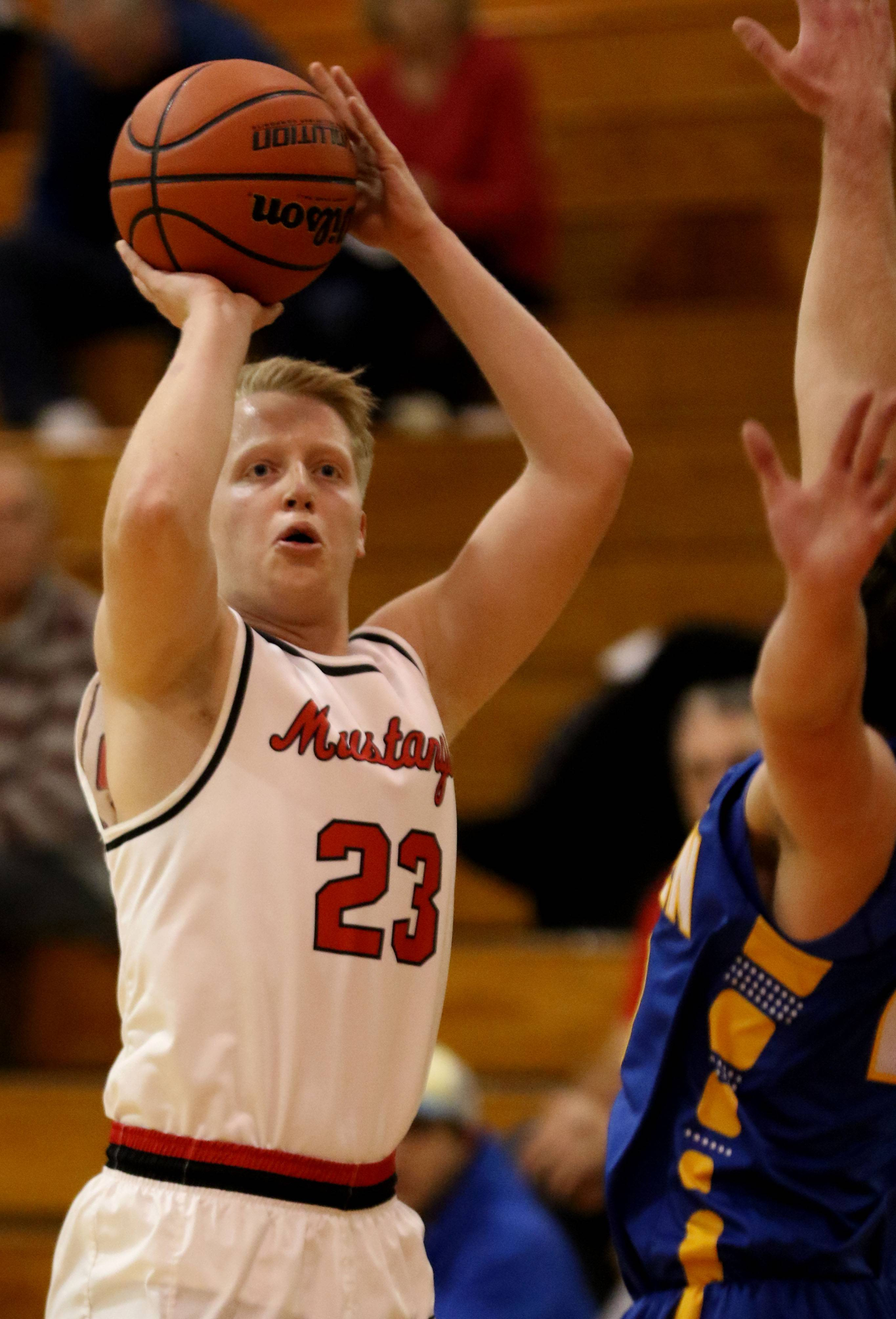Mundelein's Thomas Marcotte takes a jumper against Warren during tournament play Tuesday at Mundelein.