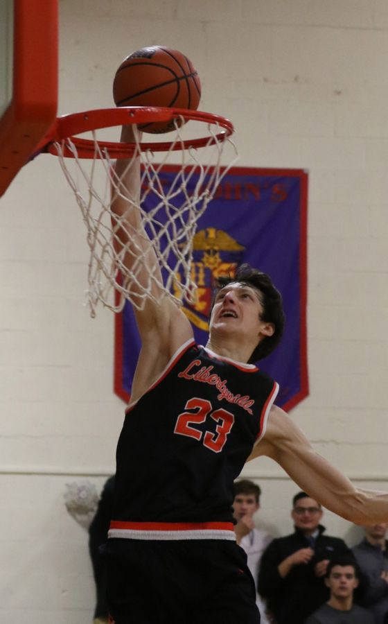 Libertyville forward Drew Peterson dunks the ball against host Lake Forest Academy on Thursday.