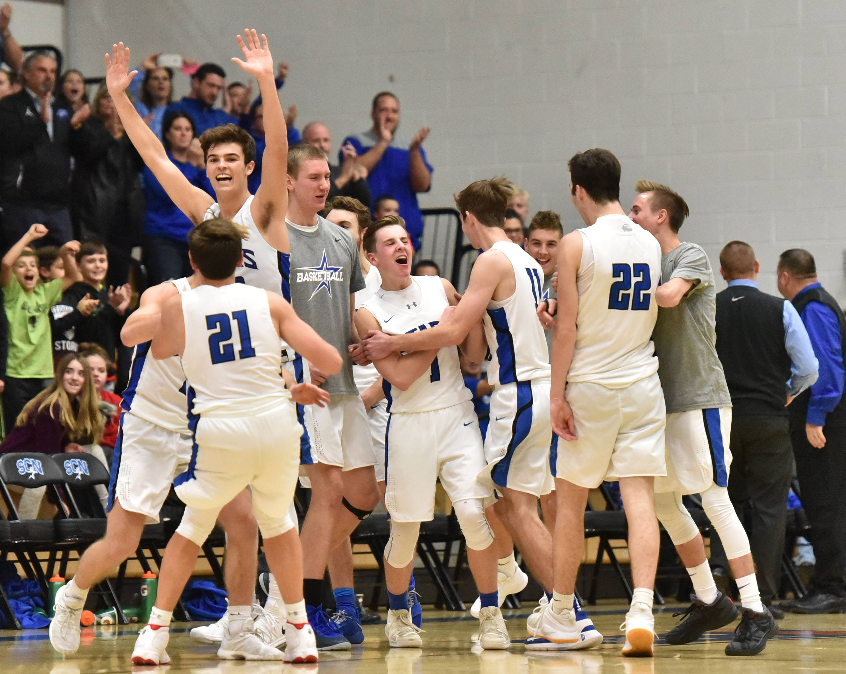 St. Charles North celebrates its win against St. Charles East Friday at North High School.