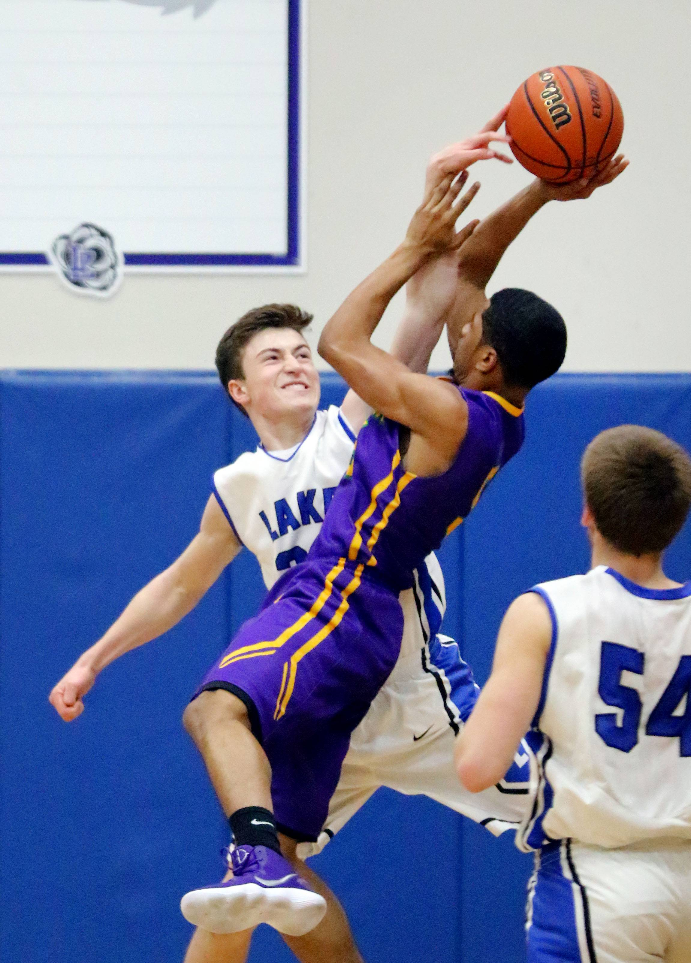 Lake Zurich's Will Tucker, left, defends against Waukegan's Jordan Brown on Friday in Lake Zurich.