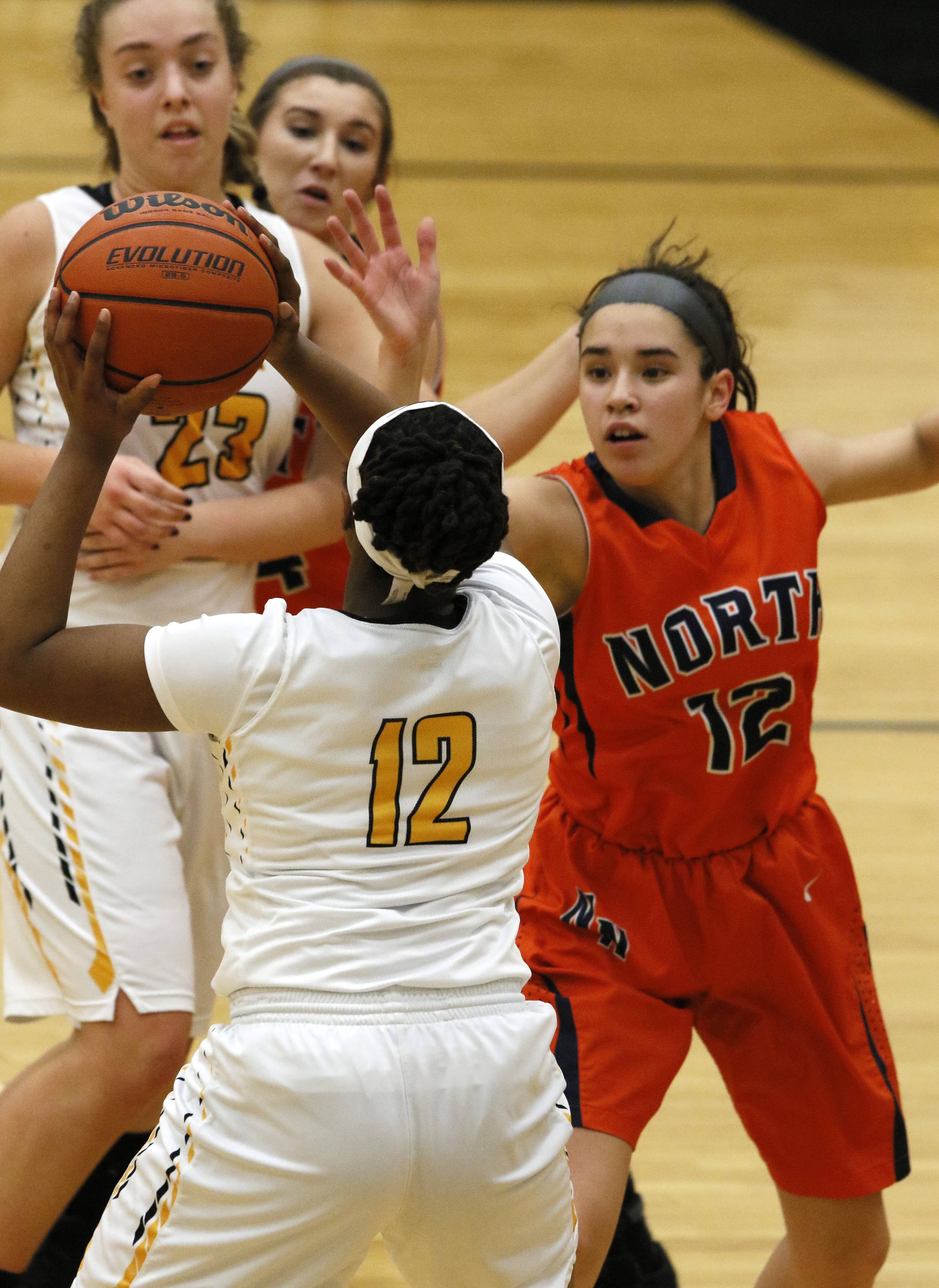 Naperville Central's Nikki Kwilosz, right, guards Metea Valley's Nazuri Whigham, left, during girls basketball action in Aurora.