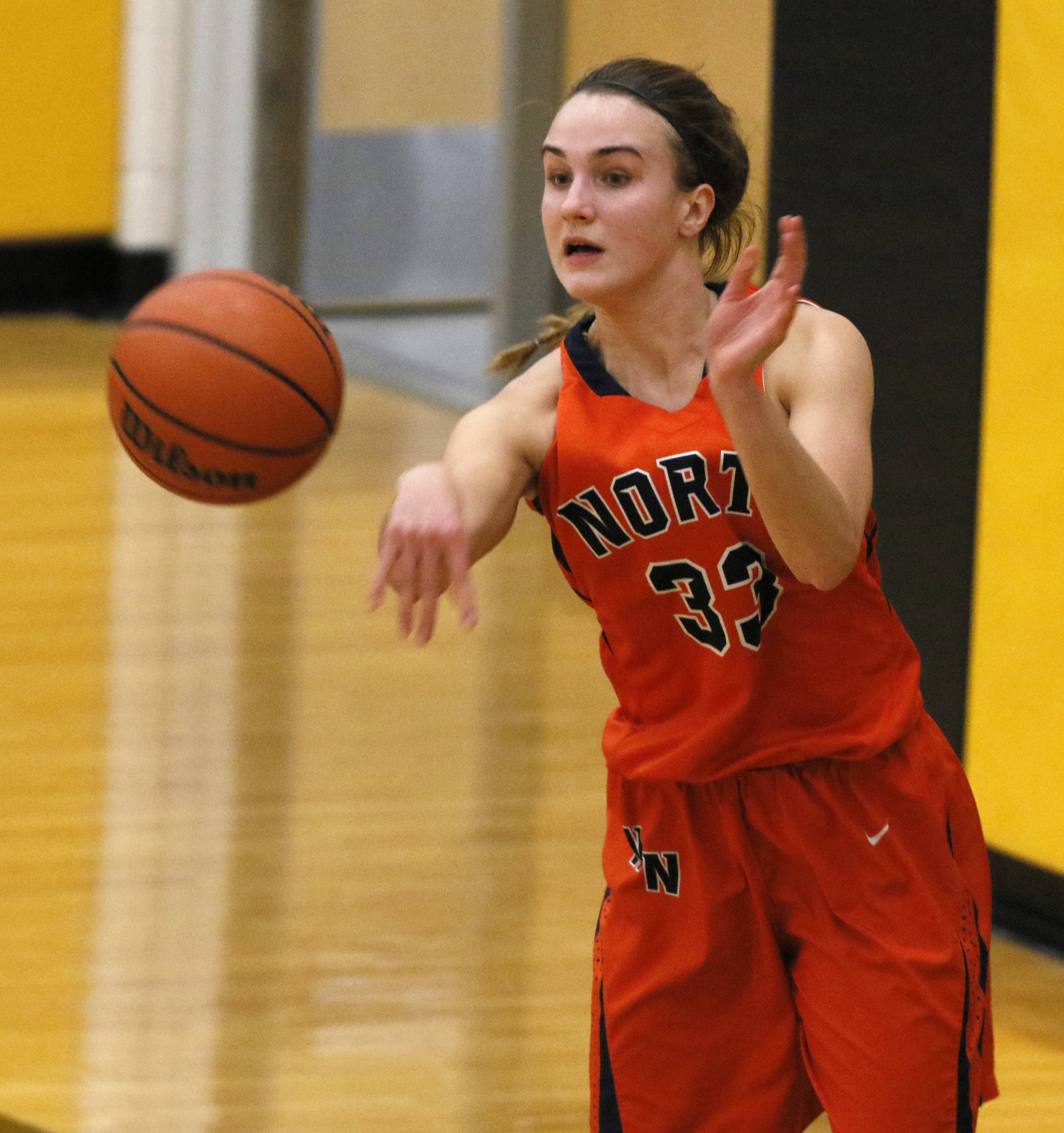 Naperville Central's Greta Kampschroeder passes the ball in bounds against Metea Valley.