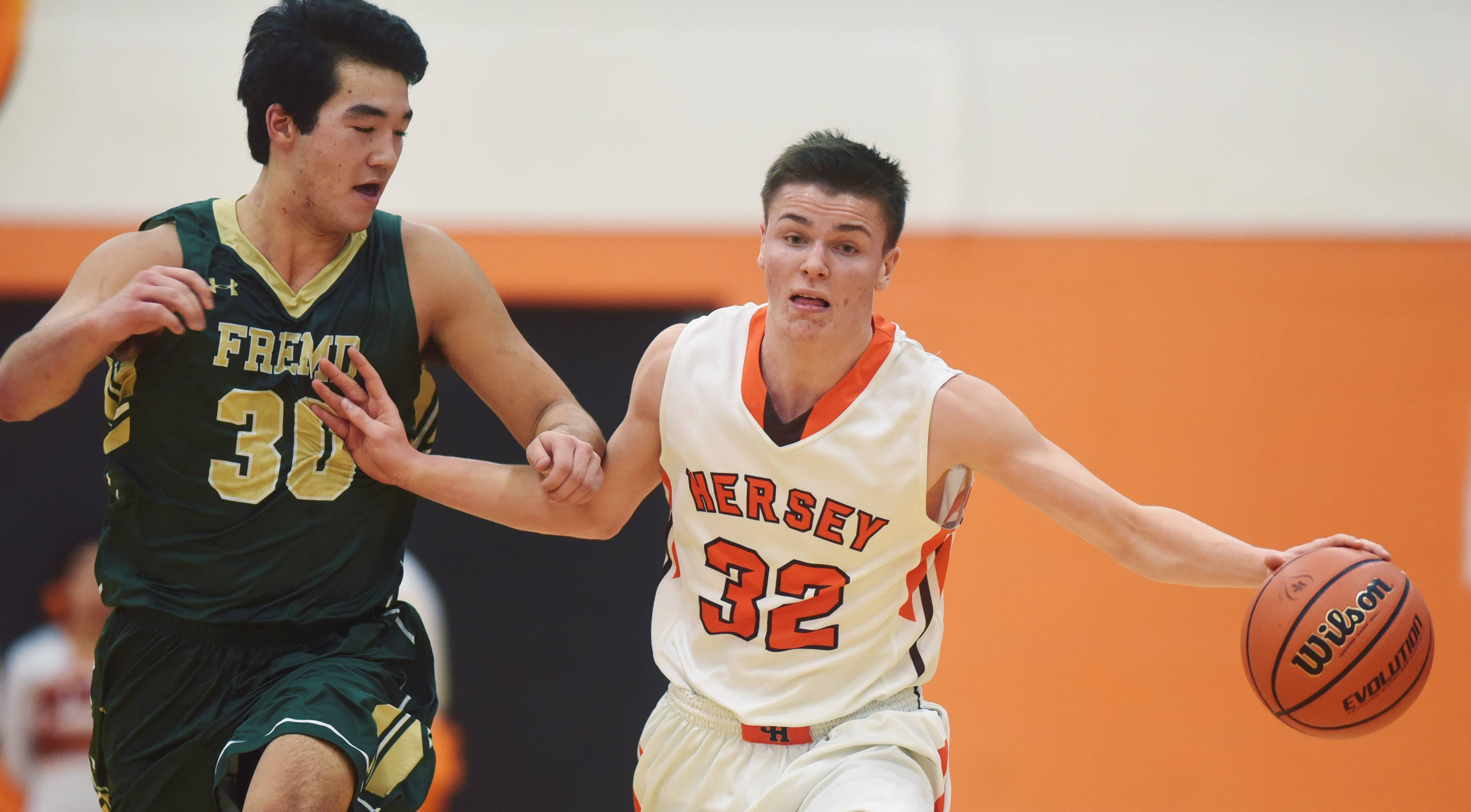 Hersey's Jason Schmidt tries to keep Fremd's Ryan Martin at arm's length during Tuesday's game in Arlington Heights.