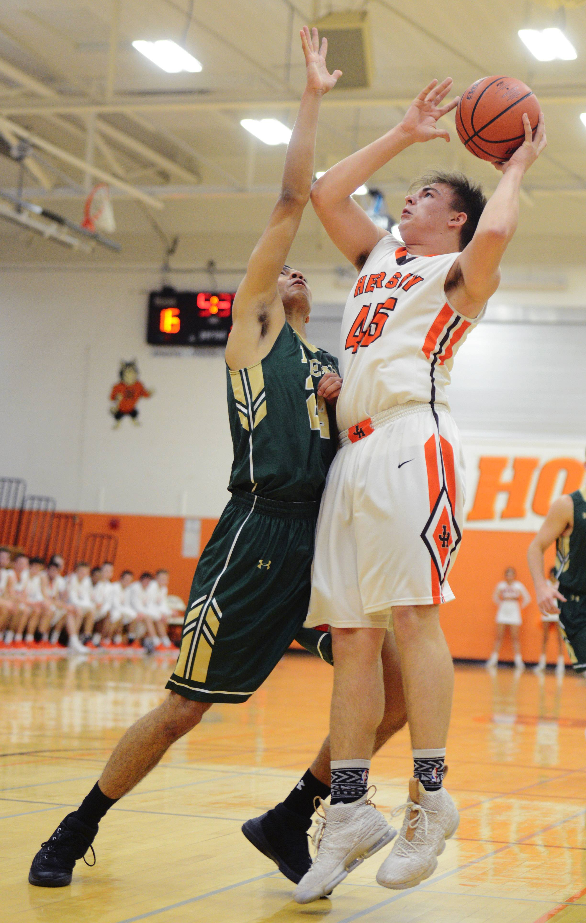Fremd's Bryce Hopkins, left, plays tight defense on Hersey's Jacob Kluczewski during Tuesday's game in Arlington Heights.