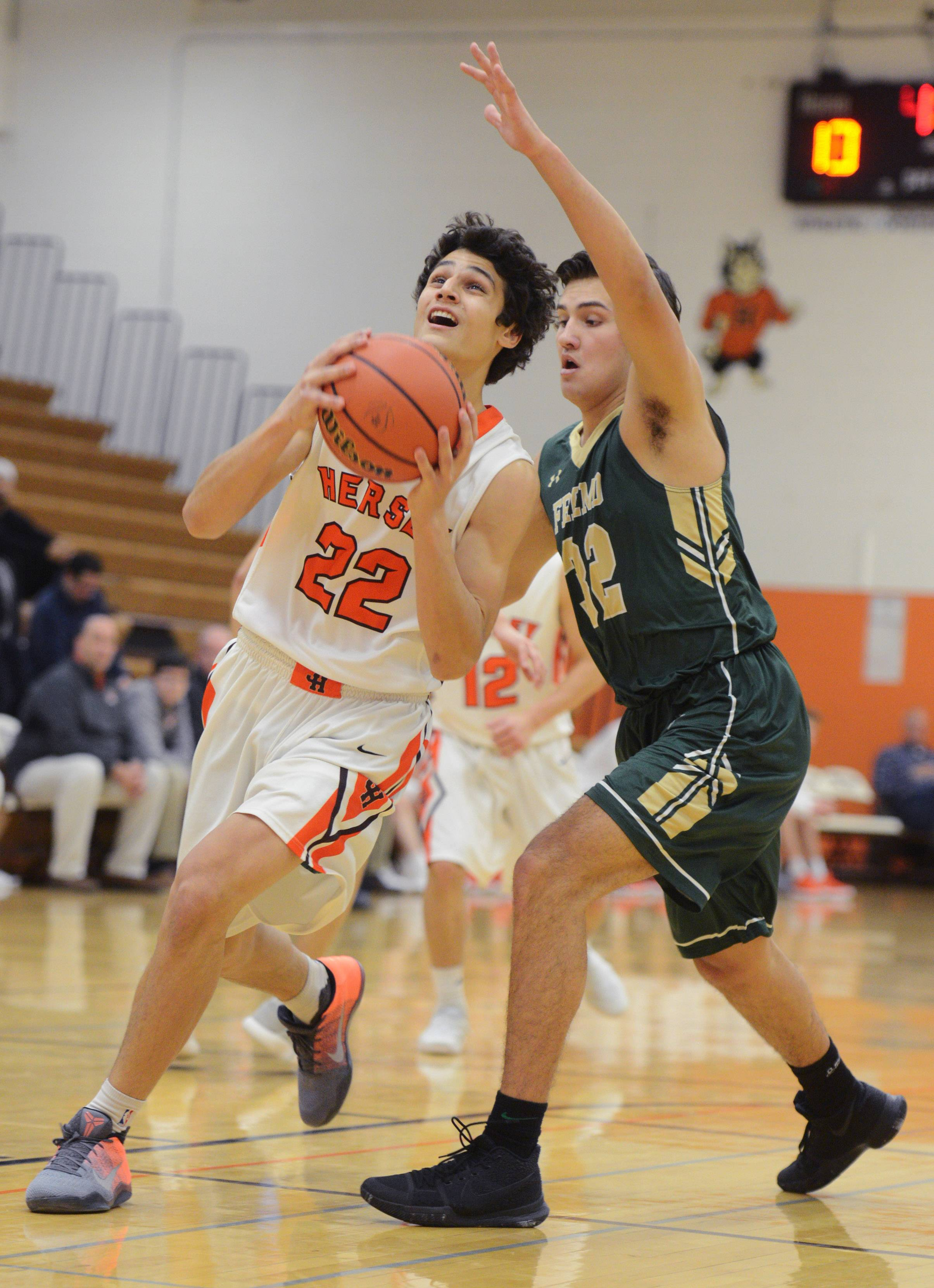 Hersey's Jace Coffaro, left, drives to the basket against the defense of Fremd's Matt Gumularz during Tuesday's game in Arlington Heights.
