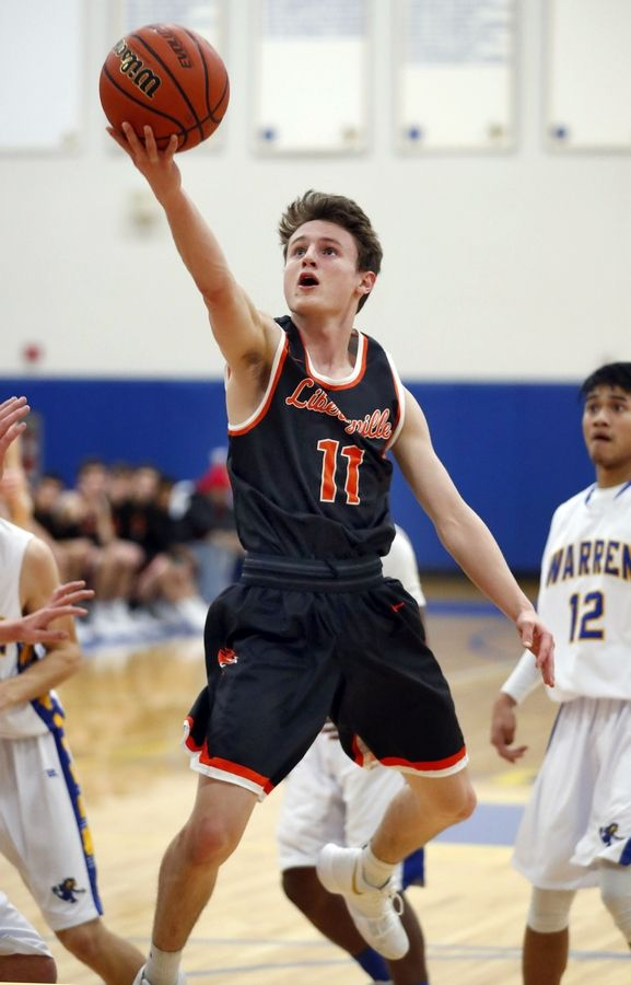 Libertyville's Josh Steinhaus goes in for a layup during their game Tuesday night in Gurnee.
