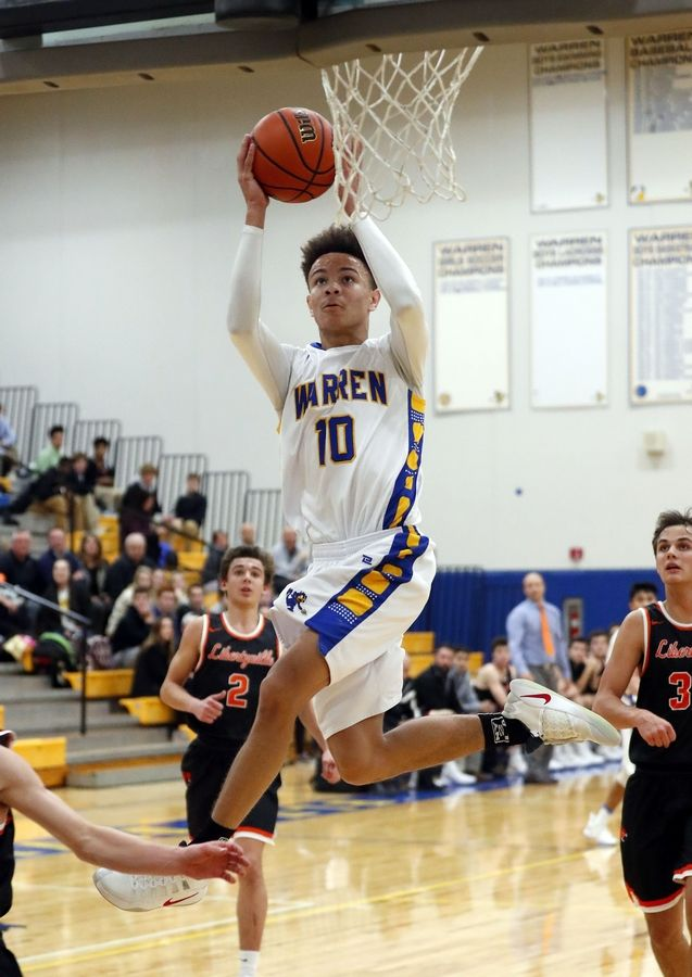Warren's Branden Ellis (10) goes in for a layup against Libertyville on Tuesday night in Gurnee.