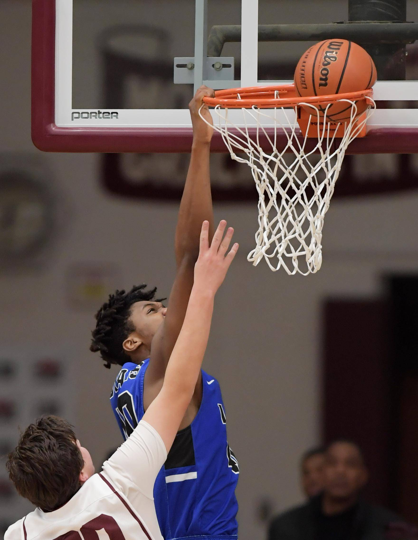 Larkin's Jalen Shaw dunks against Elgin's Jack Sitter at the end of the first quarter at  Chesbrough Field House at Elgin High School Tuesday.