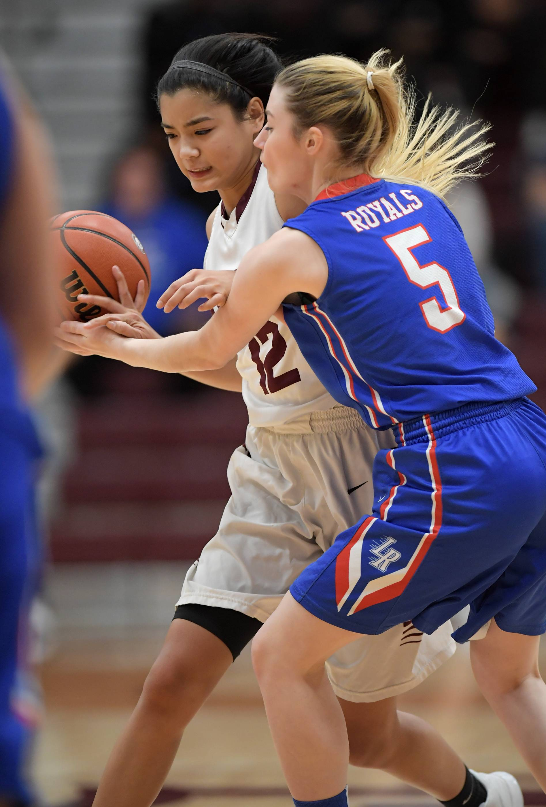 Larkin's Amber Allen forces Elgin's Raechel Untalan into a turnover Tuesday at Chesbrough Field House at Elgin High School.