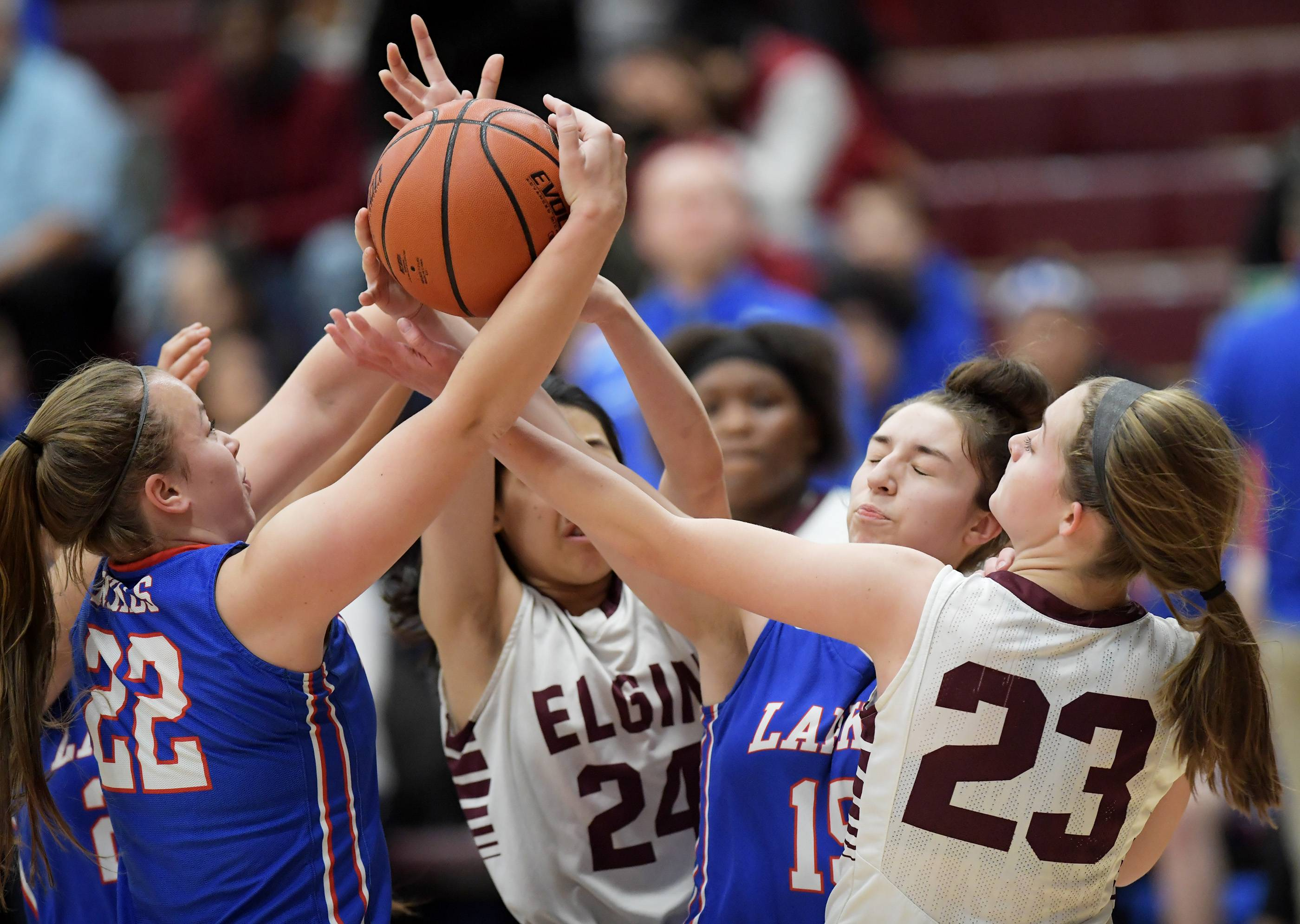 Larkin's Hailey Buttrum and Alexia Saldivar battle for a rebound with Elgin's Sabrina Chen and Kylie Graves Tuesday at Chesbrough Field House at Elgin High School.