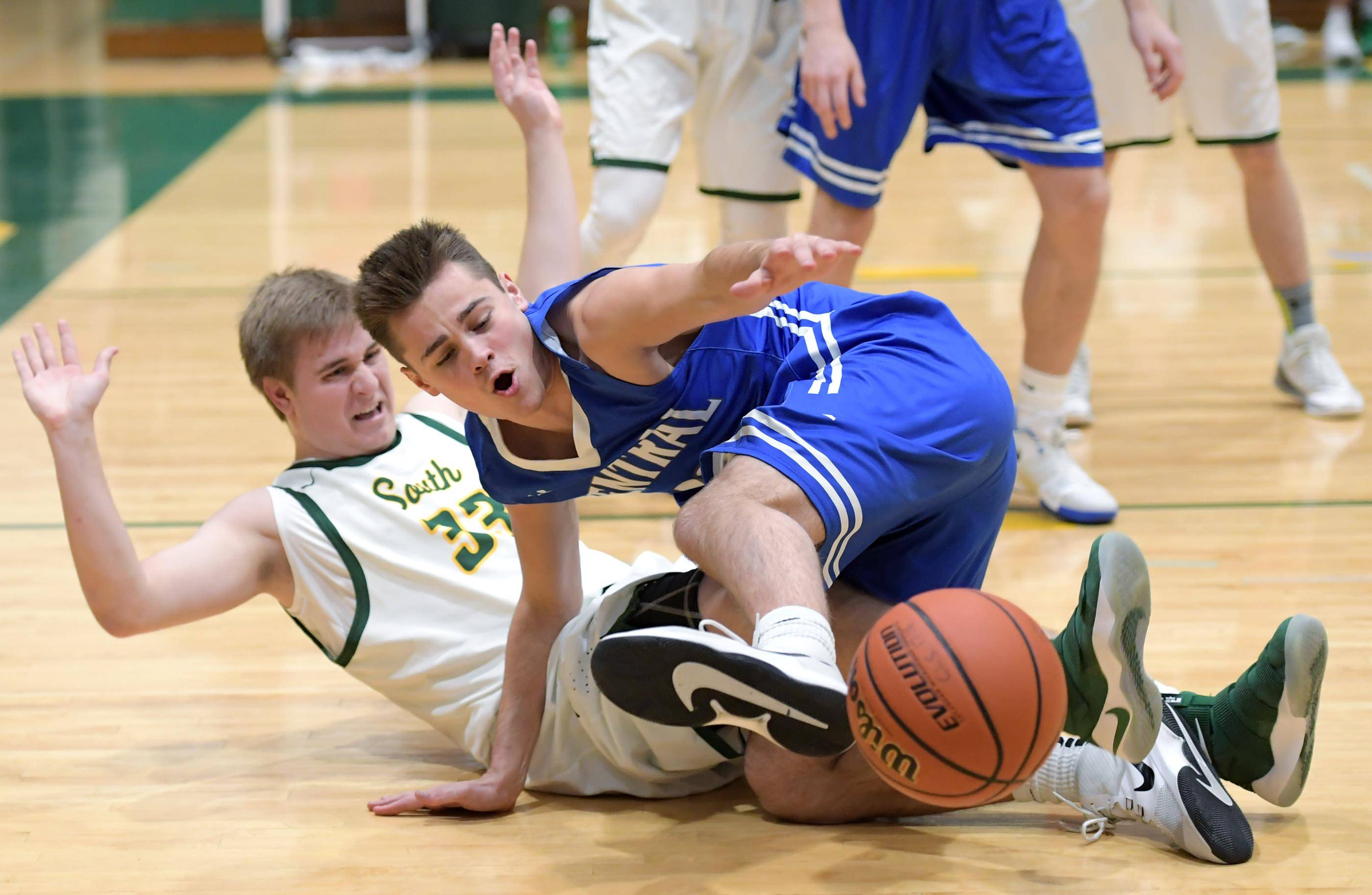 Burlington Central's Logan Andersen loses control of the ball after charging into Crystal Lake South's Tyler Haskin Wednesday in Crystal Lake. Burlington's Dejsani Beamon took control of the ball.