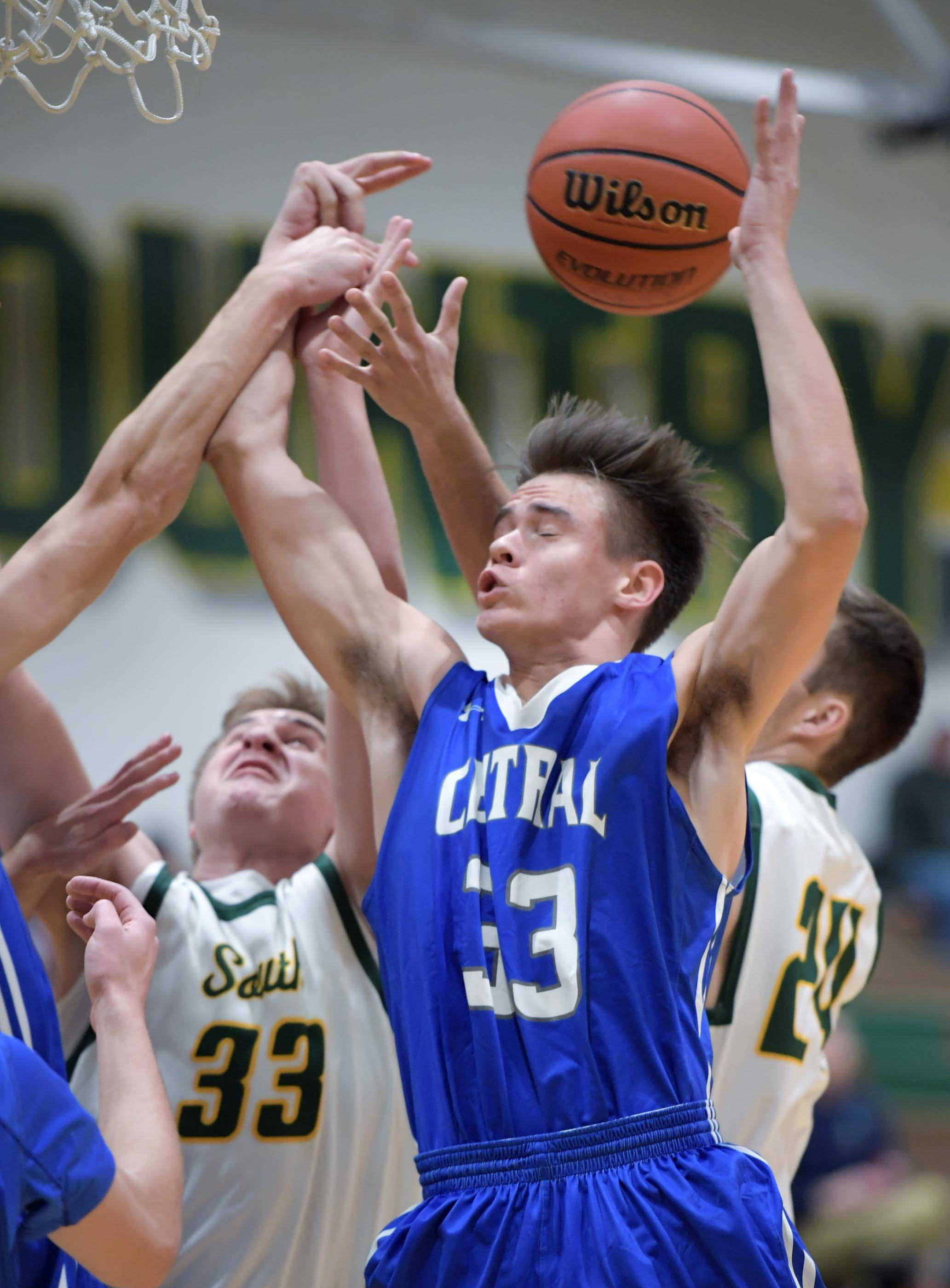 Burlington Central's Wiliam Hough and Crystal Lake South's Tyler Haskin and Blake Kuffel battle for a loose ball Wednesday in Crystal Lake.