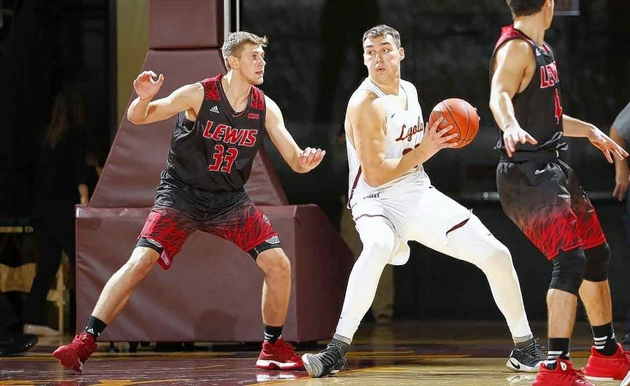 Jacobs graduate Cameron Krutwig, right, is enjoying a successful start to his college career at Loyola University.