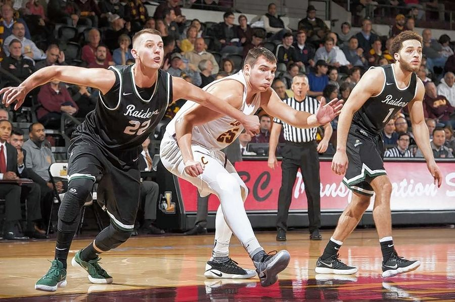 Jacobs graduate Cameron Krutwig, center, is enjoying a successful start to his college career at Loyola University.