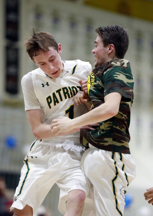 Stevenson's Matt Ambrose, left, celebrates with a teammate during Friday's game against visiting Mundelein.