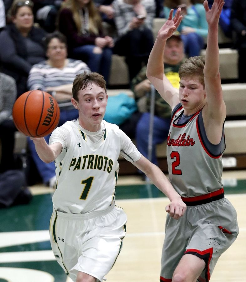 Stevenson's Matthew Ambrose dishes off around Mundelein's James Willman on Friday night in Lincolnshire.