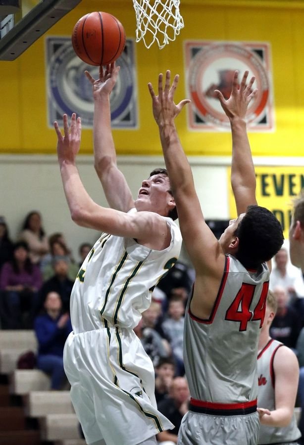 Stevenson's Nick Bonk, left, shoots over Mundelein's Andrew Silva on Friday night in Lincolnshire.
