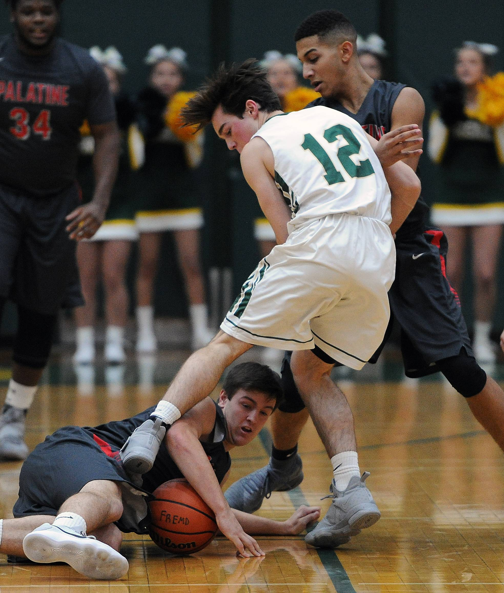 Palatine's Johnny O'Shea scrambles for the ball as Fremd's Luke Seidel tries to avoid stepping on him in the first quarter Friday at Fremd.