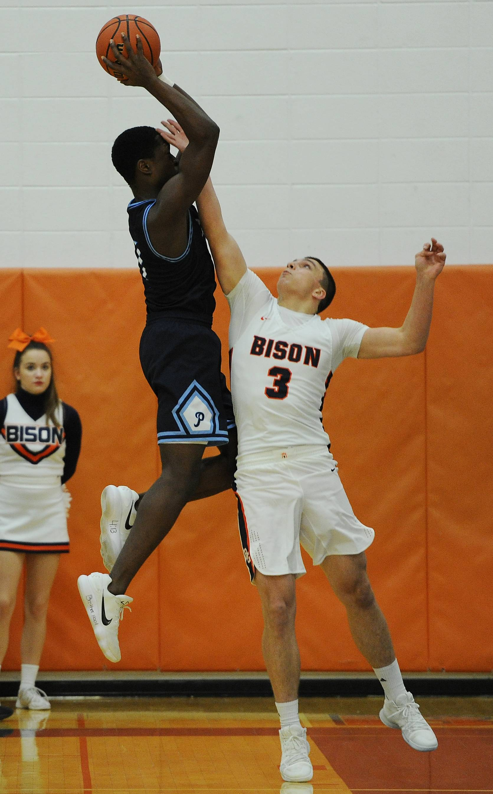 Prospect's Jalen McLachlan goes up for a rebound against Buffalo Grove's Tom Trieb and catches an elbow to his eye, which knocked him out of most of the first half Friday at Buffalo Grove.