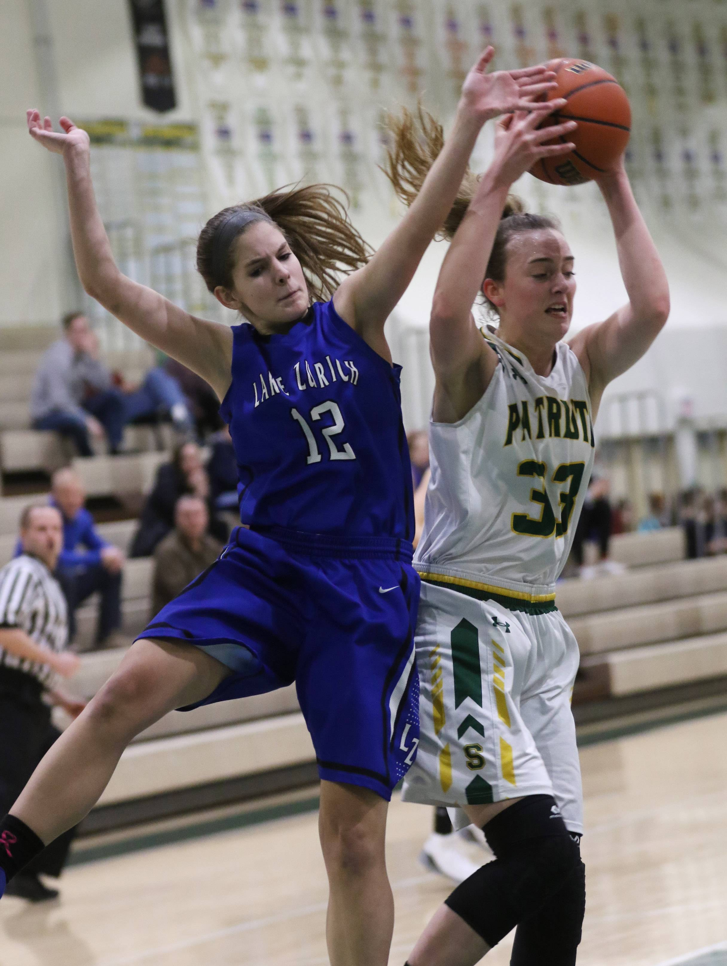 Stevenson forward Klaire Steffens rebounds the ball and takes it away from Lake Zurich guard Brigid Ferguson on Thursday at Stevenson.