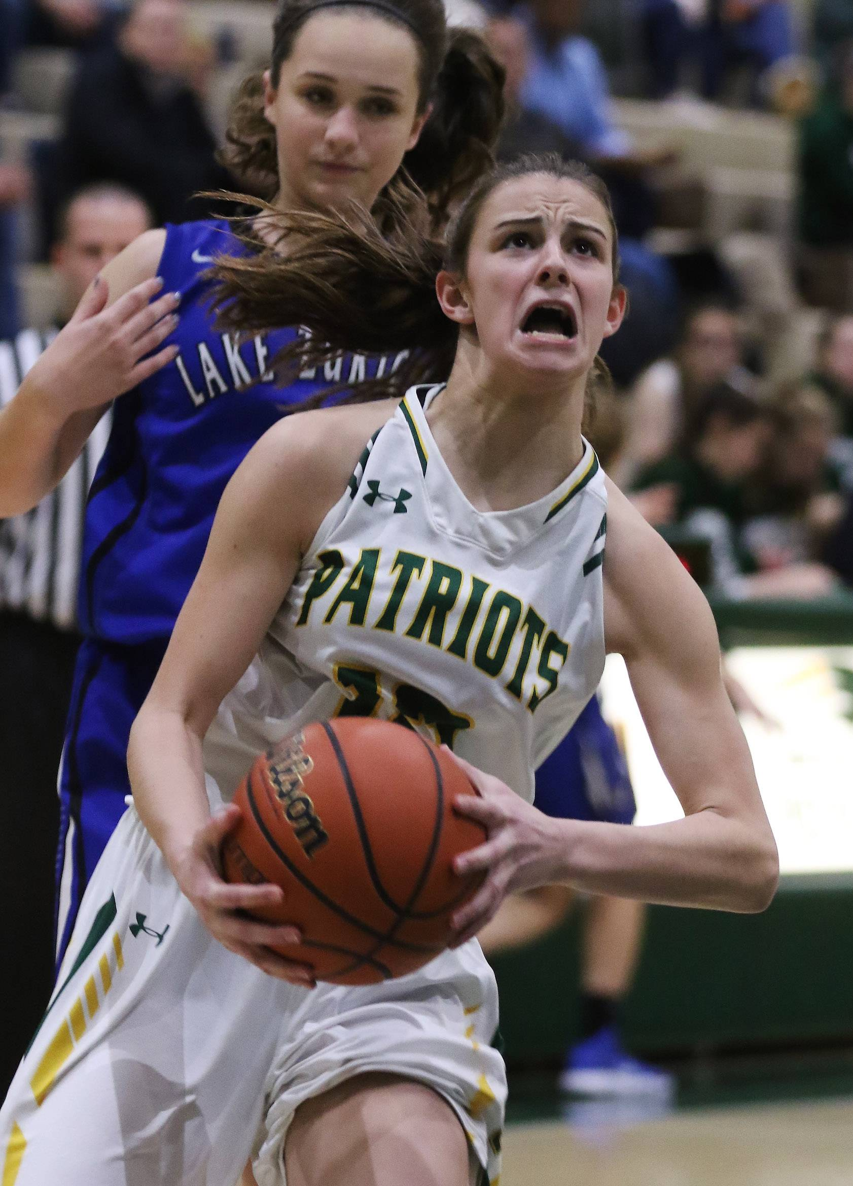Stevenson guard Krissy Hill drives to the basket past Lake Zurich guard Margueret Spear on Thursday at Stevenson.
