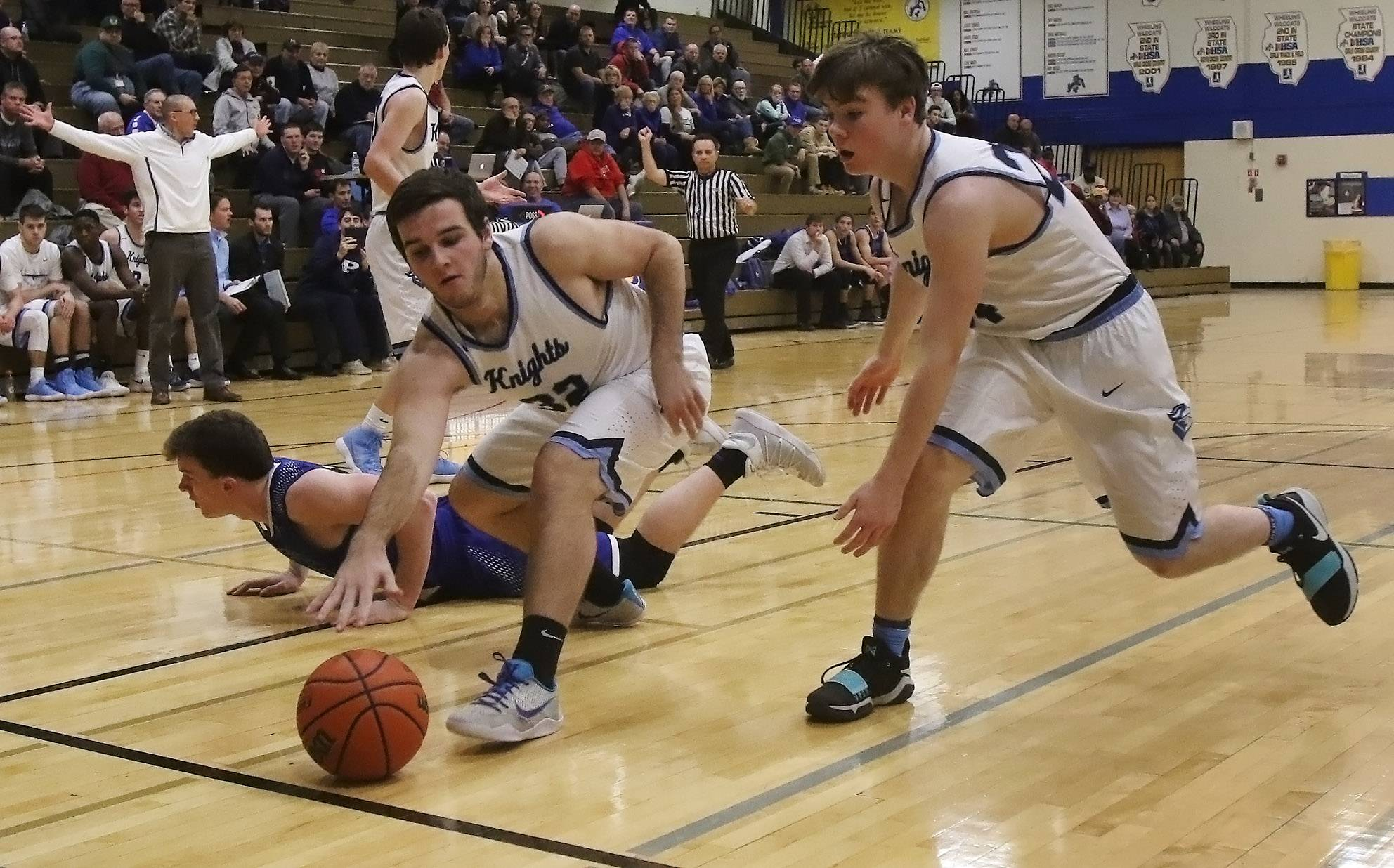 Prospect players Zach Matters, left, and T.J. Johannesen go for a loose ball during Thursday's matchup against Geneva at Wheeling's Hardwood Classic.