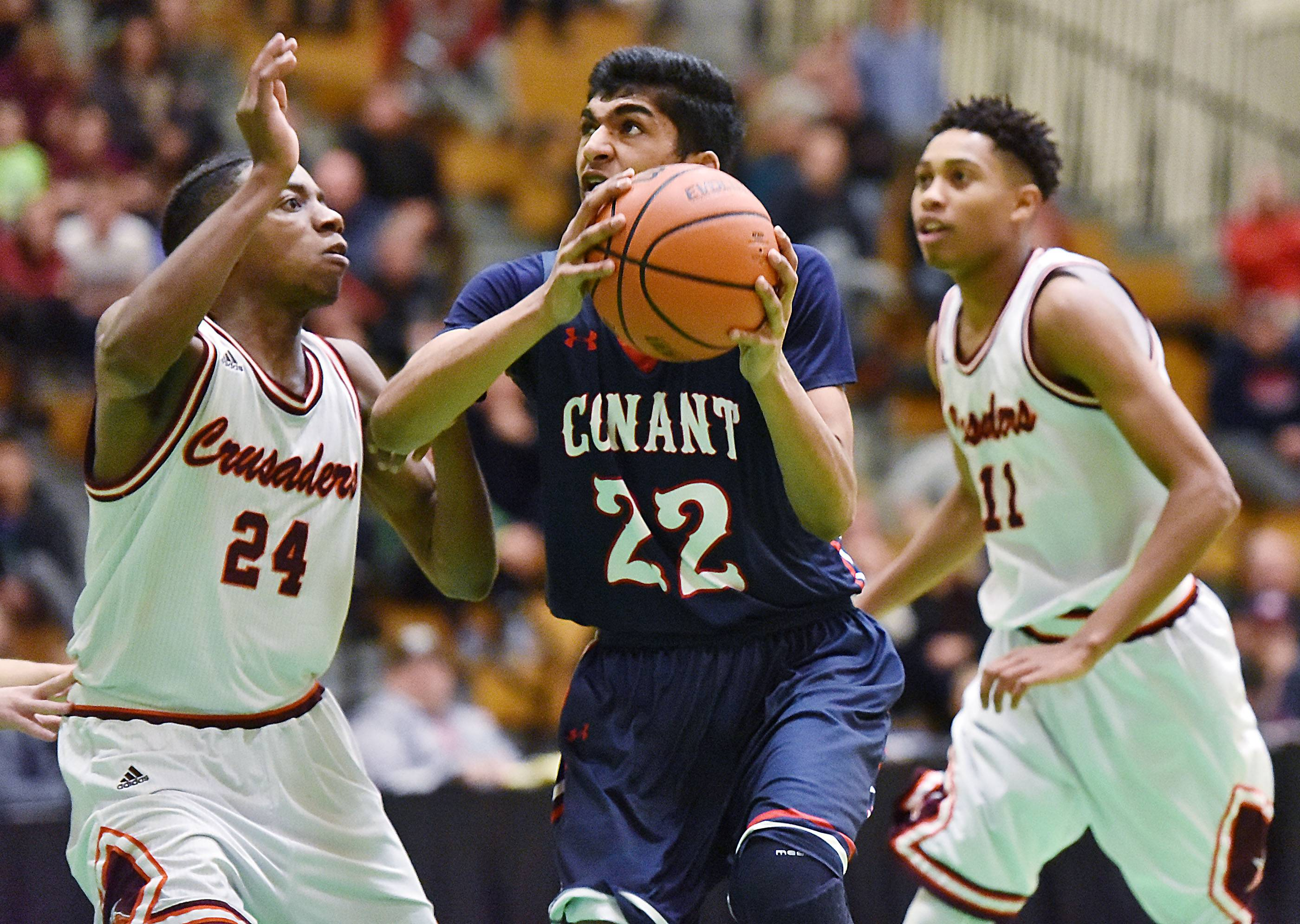 Conant's Raj Mittal drives against Brother Rice's Marquise Kennedy on Saturday at York High School in Elmhurst.