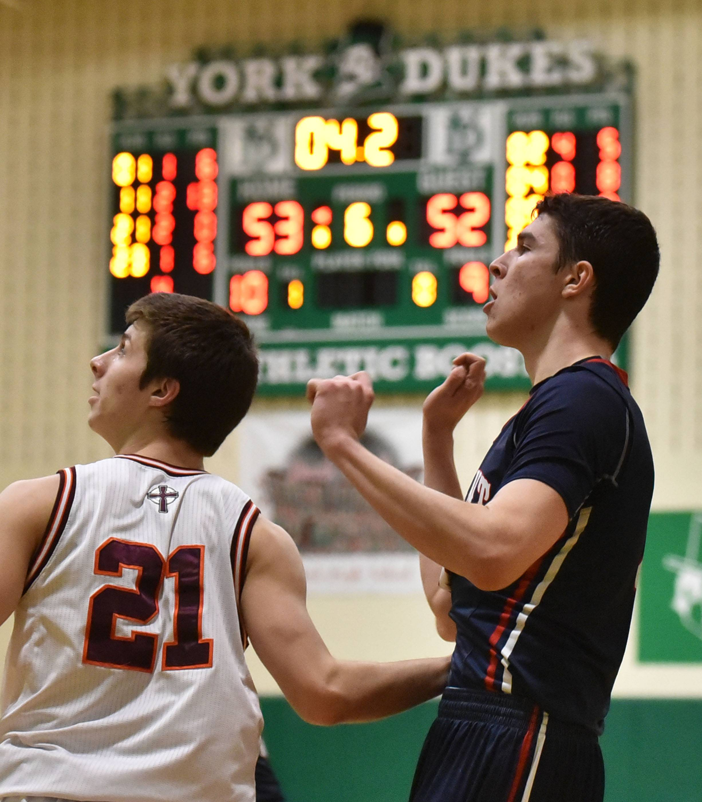 Conant's Jonathan Kolev, right, and Brother Rice's Matt Fitzpatrick watch Kolev's game-winning shot, which made it 54-53 in the Cougars' favor with 4.2 seconds left in double ovetime Saturday at York High School in Elmhurst..
