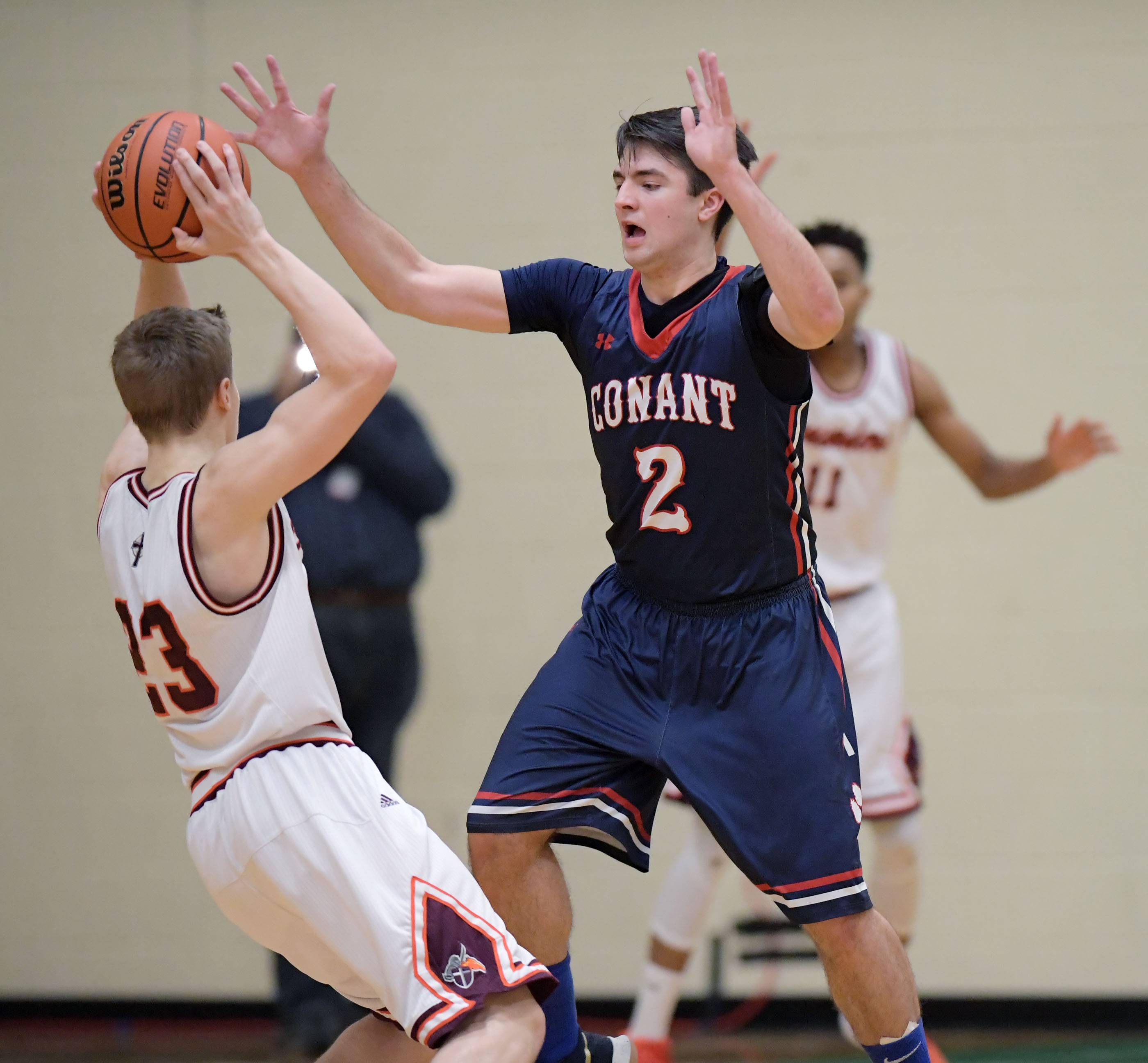 Conant's Ben Schols defends against Brother Rice's Brendan Coghlan on Saturday at York High School in Elmhurst.