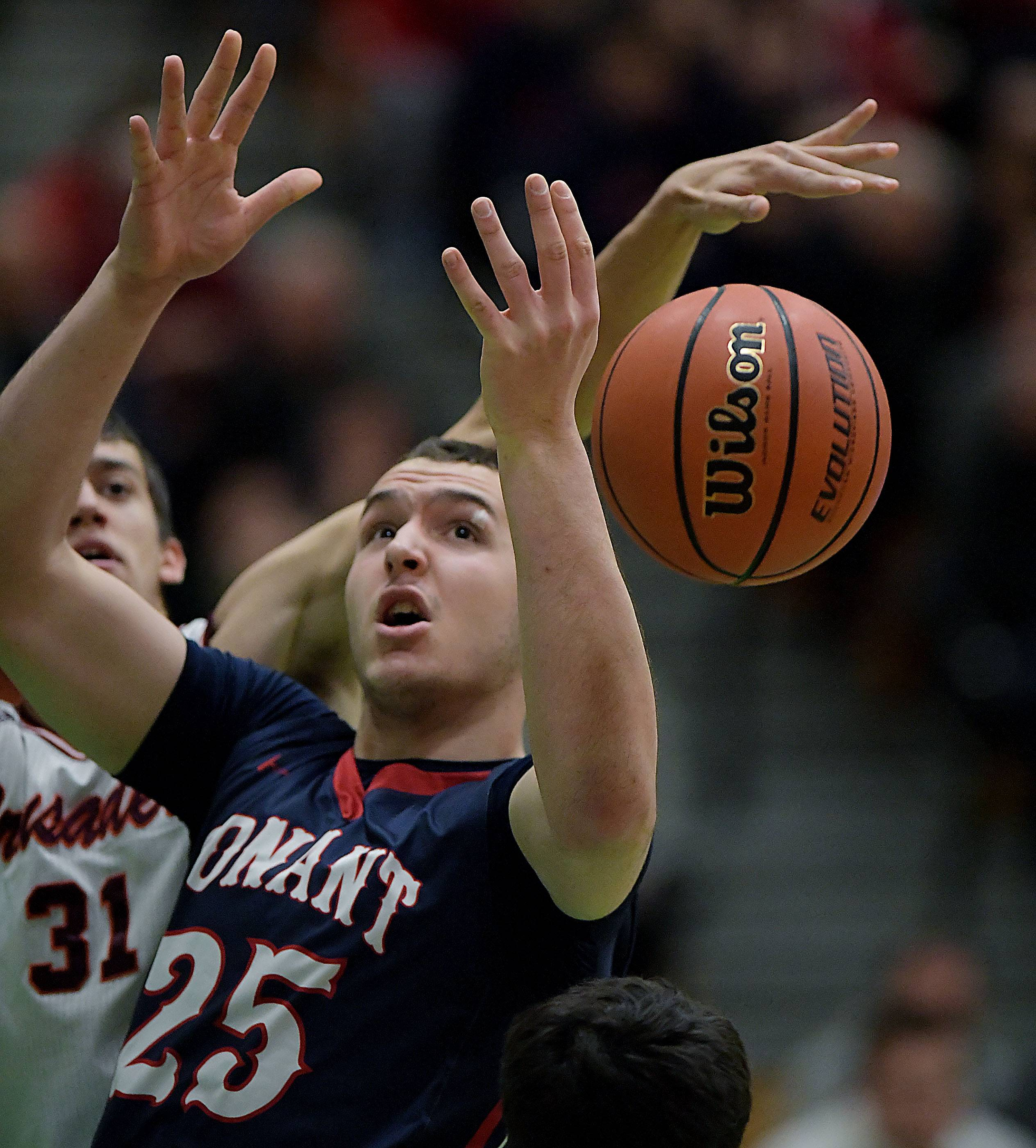 Conant's Ryan Davis loses the ball under defensive pressure from Brother Rice's Nick Bowes on Saturday at York High School in Elmhurst.