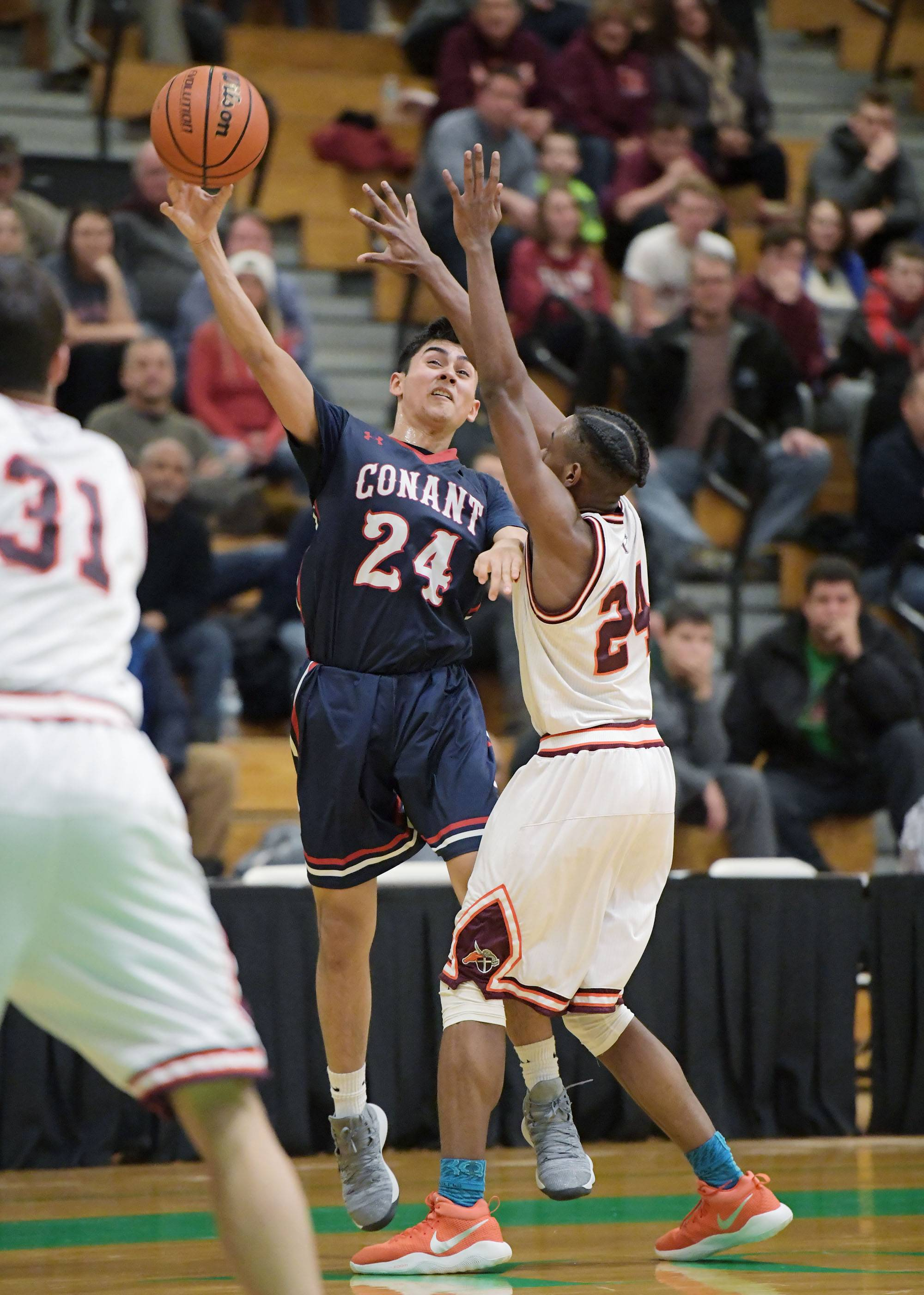 Conant's Joe Arriaga passes around Brother Rice's Marquise Kennedy on Saturday at York High School in Elmhurst.