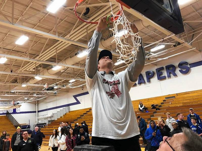 burlington central boys basketball coach brett porto cuts down the net after the rockets won the - Plano Christmas Classic