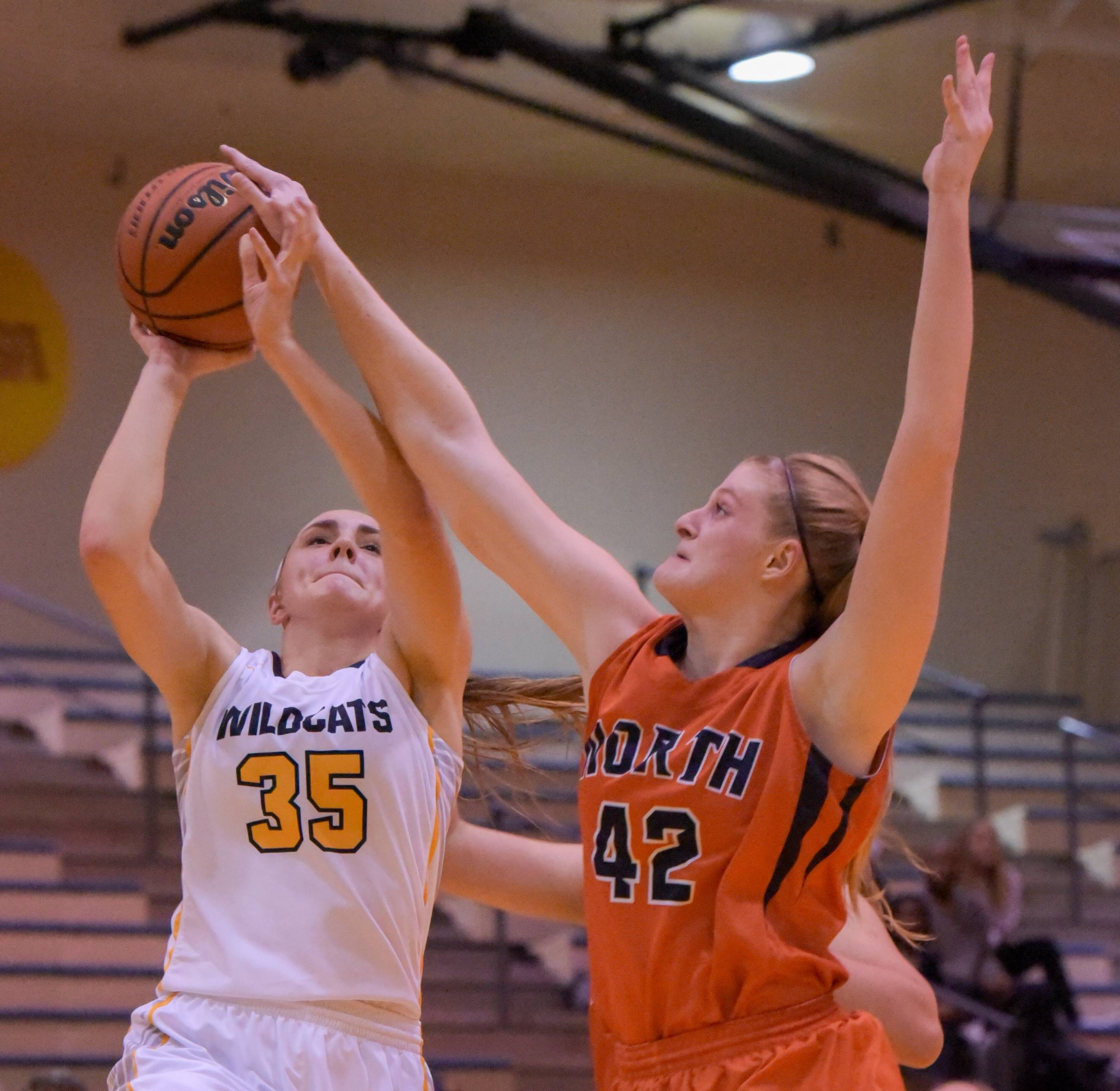 Neuqua Valley's Erin McCarthy has her shot blocked by Naperville North's Sadie Jurkovic during girls basketball at on Wednesday, Jan. 10, 2018.