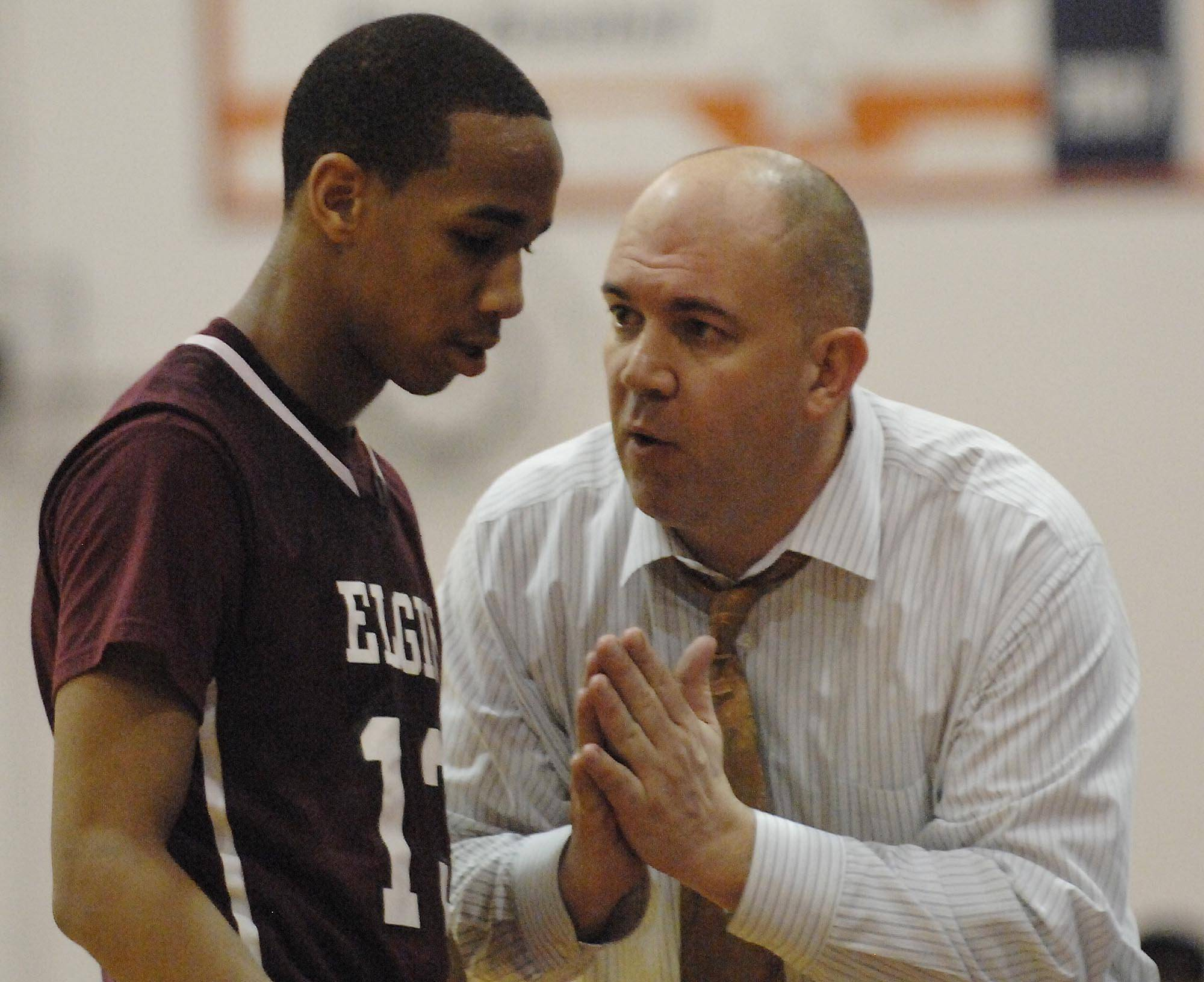 Elgin High boys basketball coach Mike Sitter, right, has been named the new athletic director at Hampshire High School effective July 1.