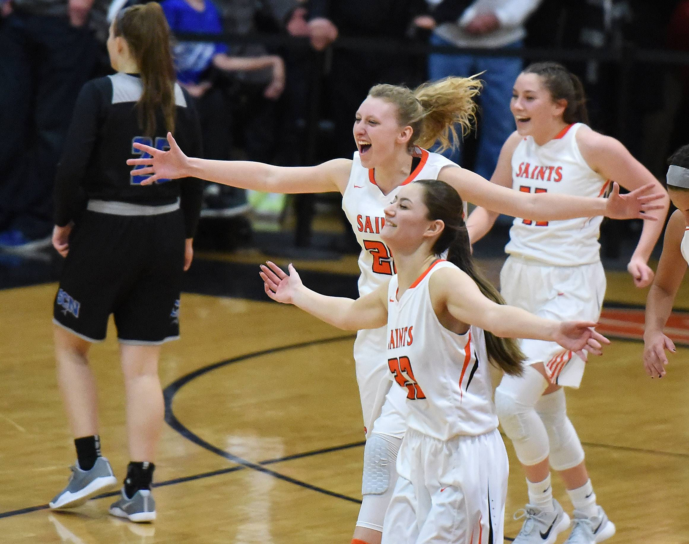 St. Charles East players, including Alexis Kiefer, top middle, and Katherine Weinzirl, bottom, celebrate after their win over St. Charles North during Friday's game at East.