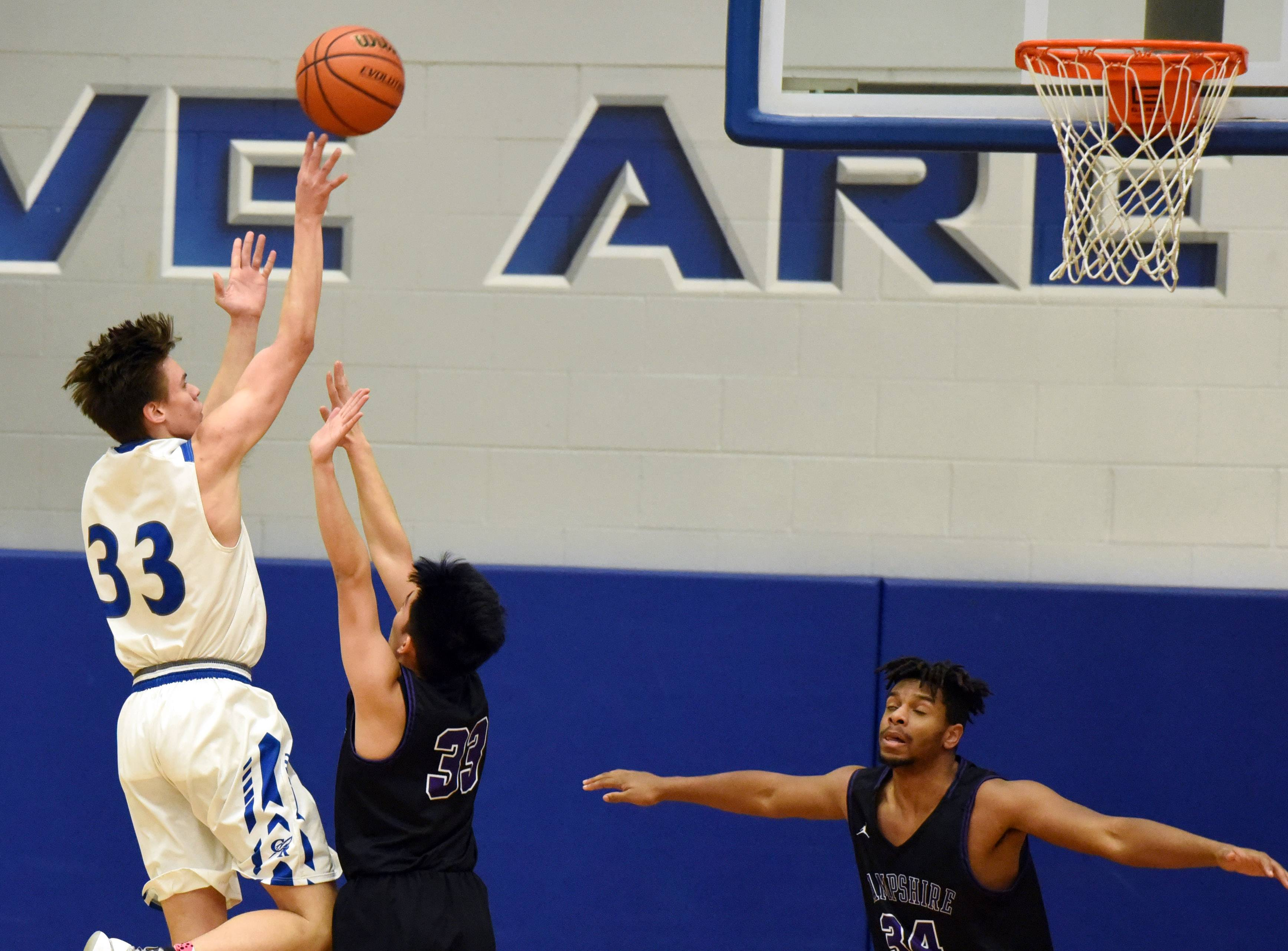 Burlington Central's William Hough puts up a shot over  Hampshire's Ethan Gonzales during Monday's game at the 3rd annual Central MLK Classic in Burlington.