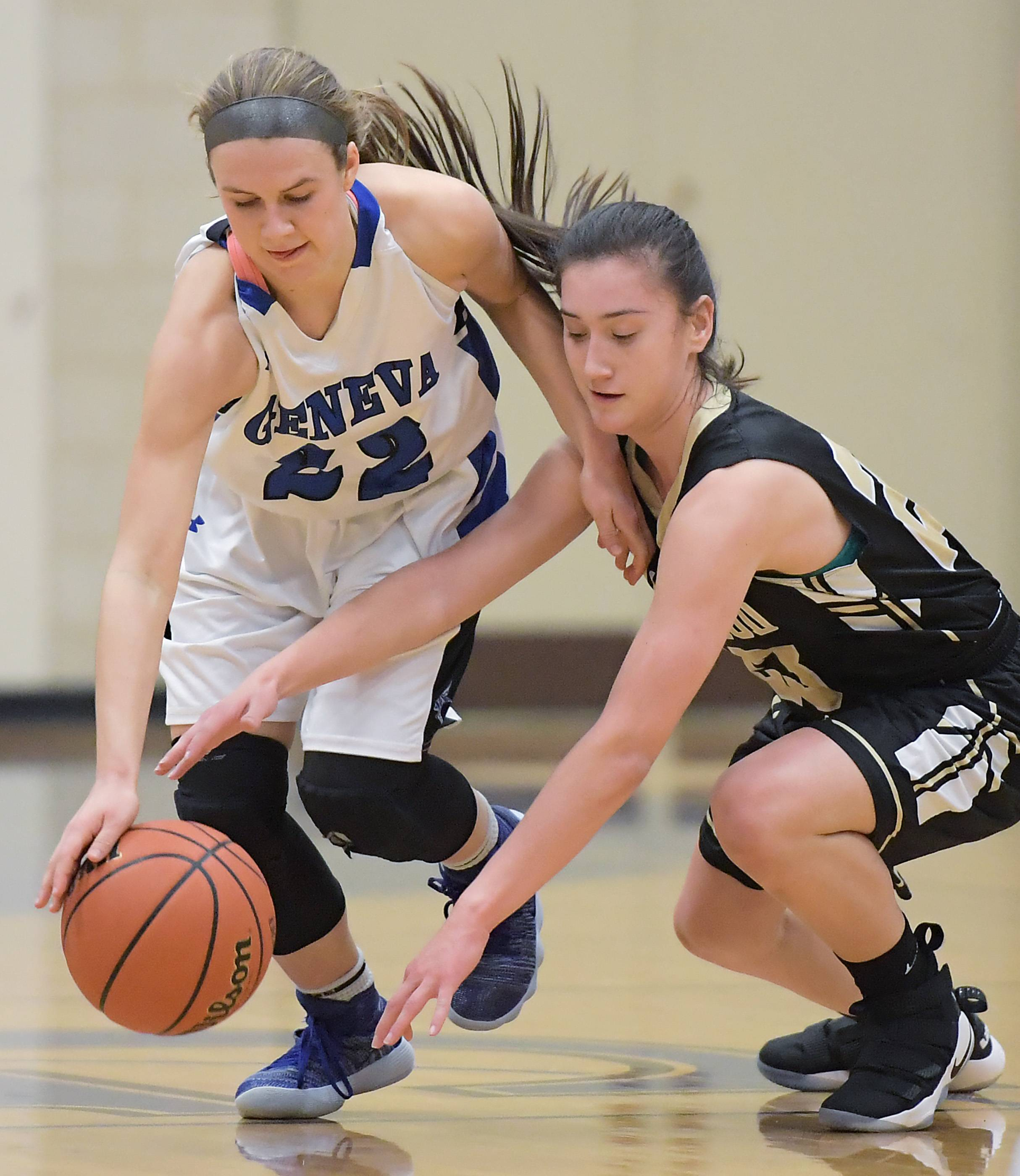 Geneva's Briana Borkowicz tries to keep Streamwood's Monica Brown away from the ball during a girls basketball game Tuesday in Geneva.
