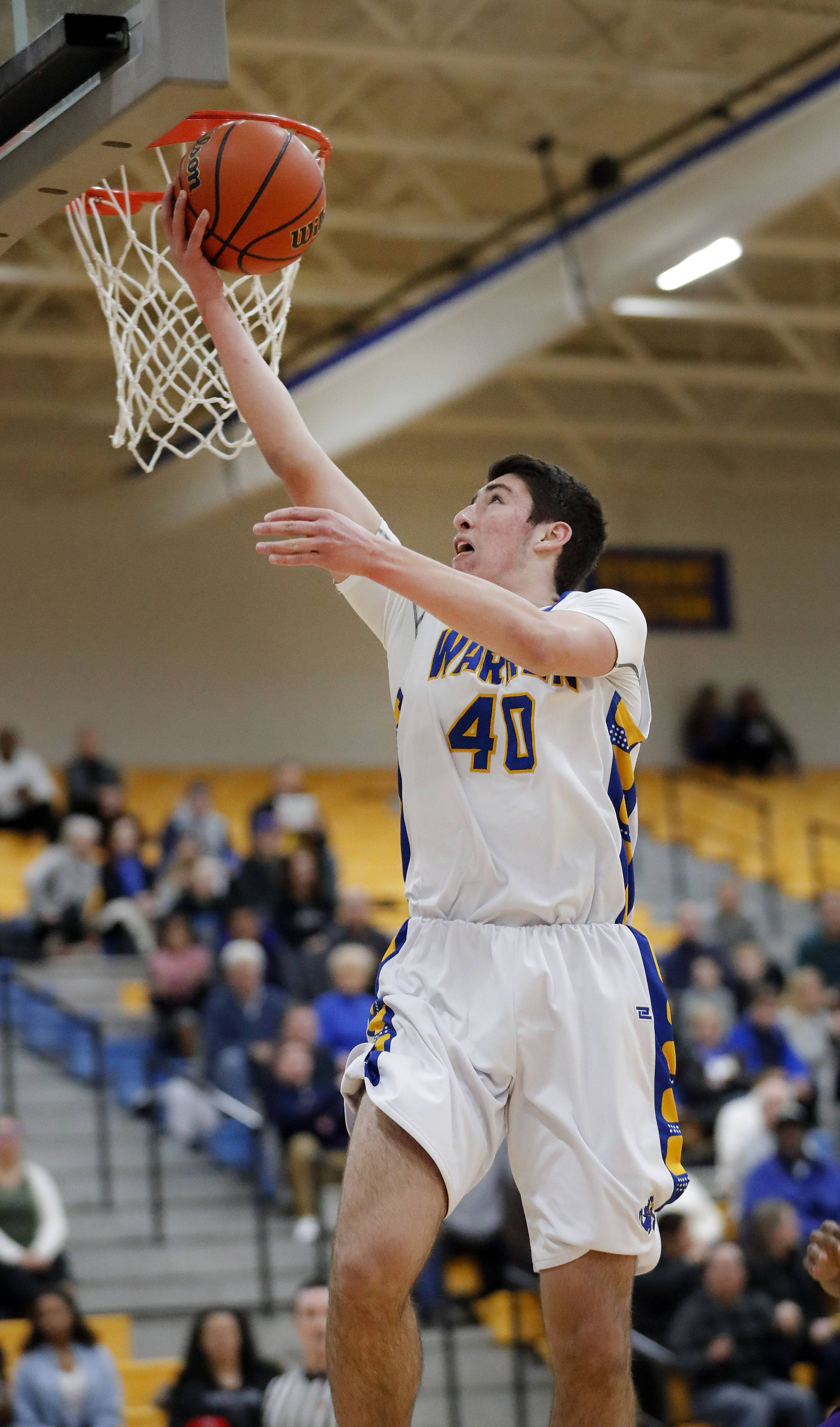 Warren's Adnan Sarancic drives for a layup against Waukegan on Wednesday night in Gurnee.