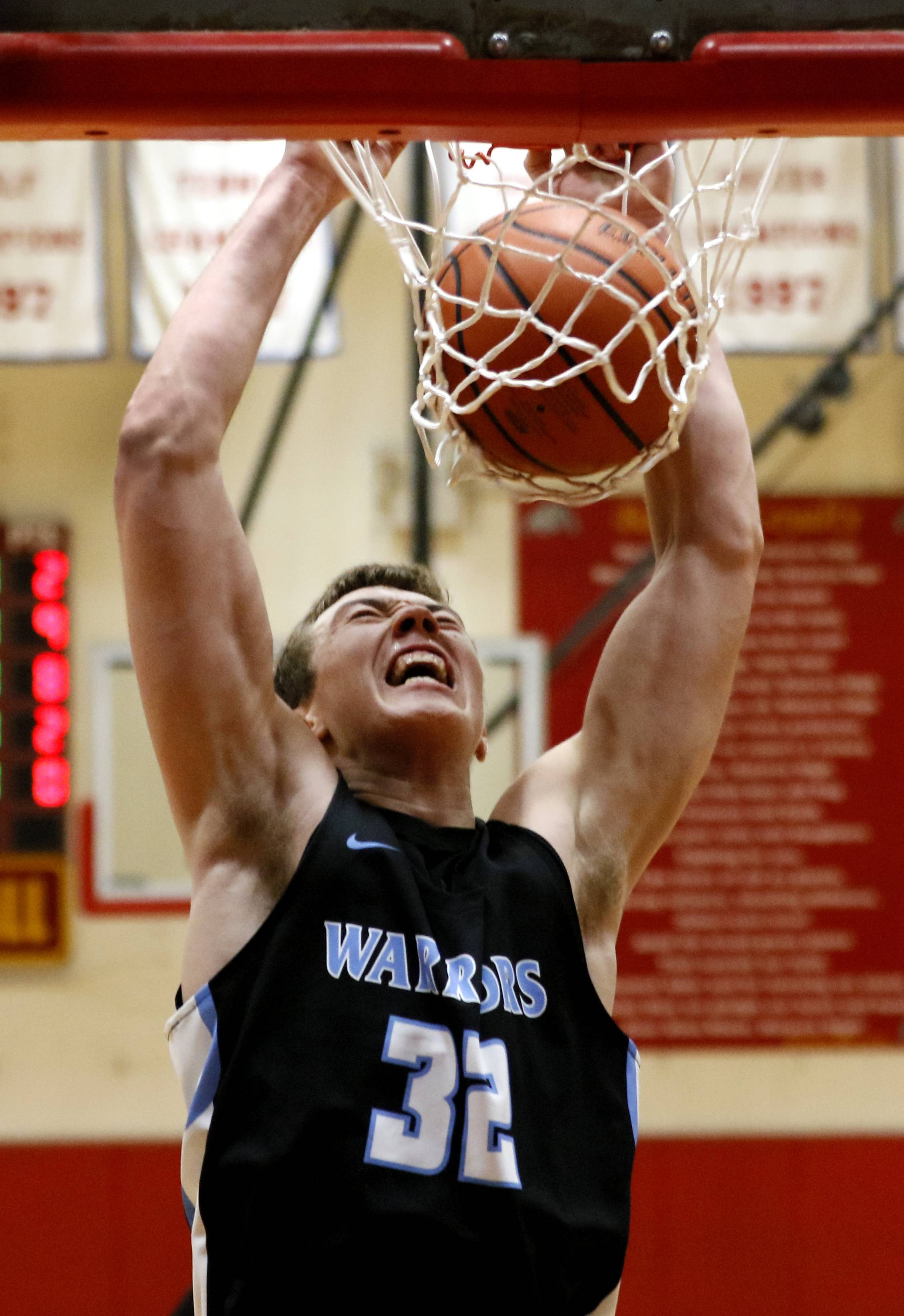 Willowbrook's Ethan Chuemer jams the ball against West Aurora during the 25th annual Jim & Sylvia Roberts Night of Hoops boys basketball game at Batavia High School.