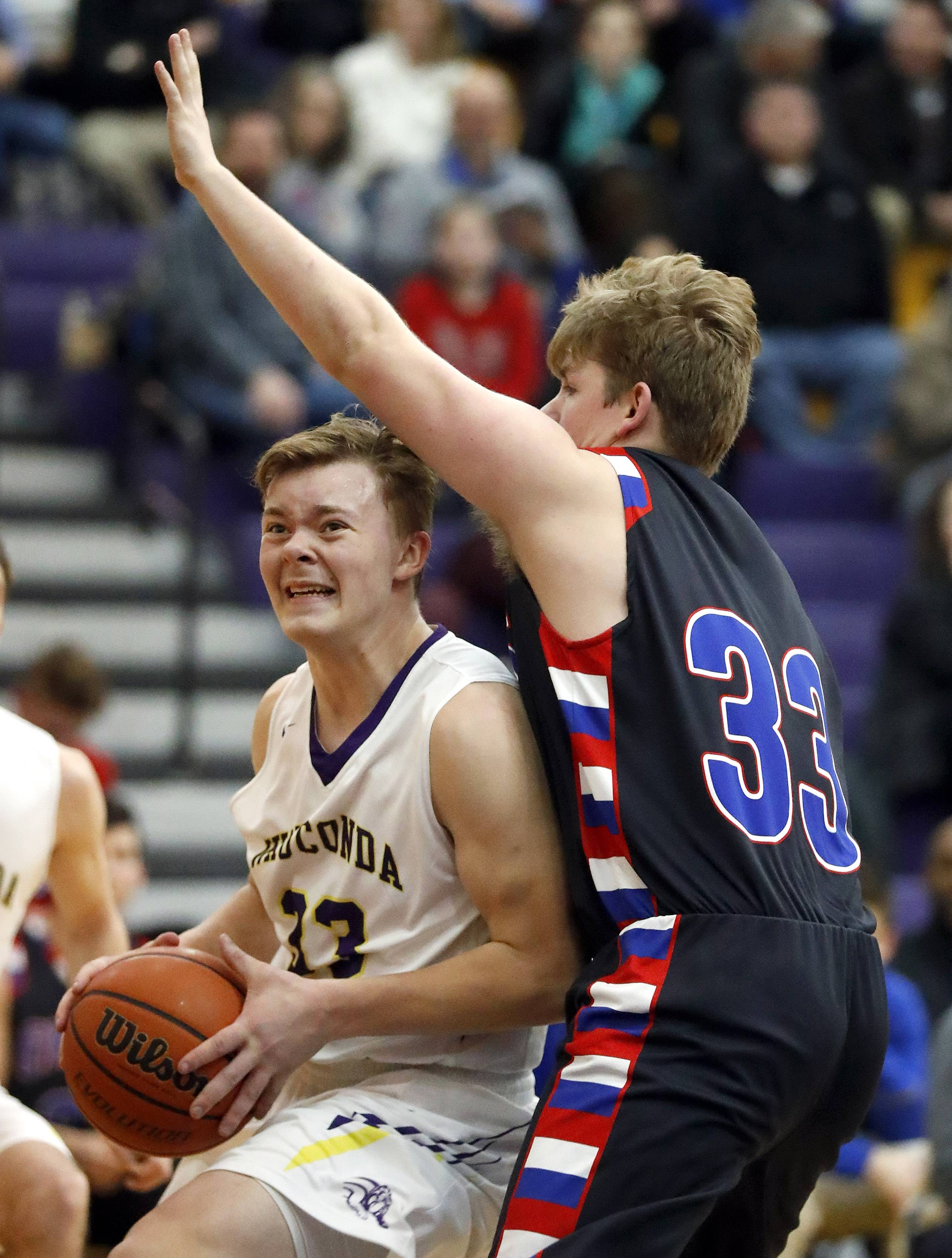 Wauconda's Andrew Nolan, left, drives on Lakes' Tylor Gunther on Tuesday night in Wauconda.