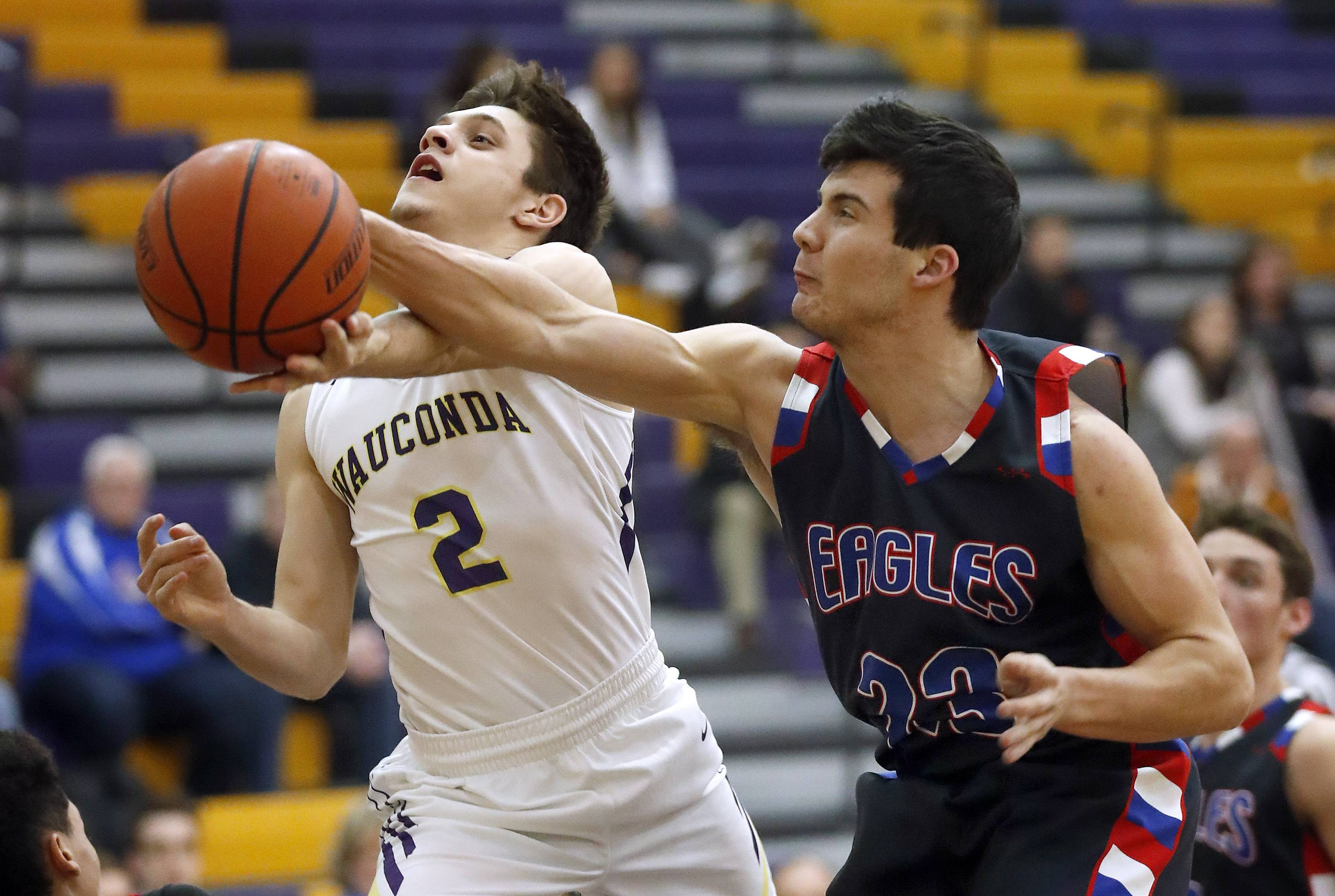 Wauconda's Nick Rinchiuso (2) has his shot blocked by Lakes' Ethan Greenfield on Tuesday night in Wauconda.