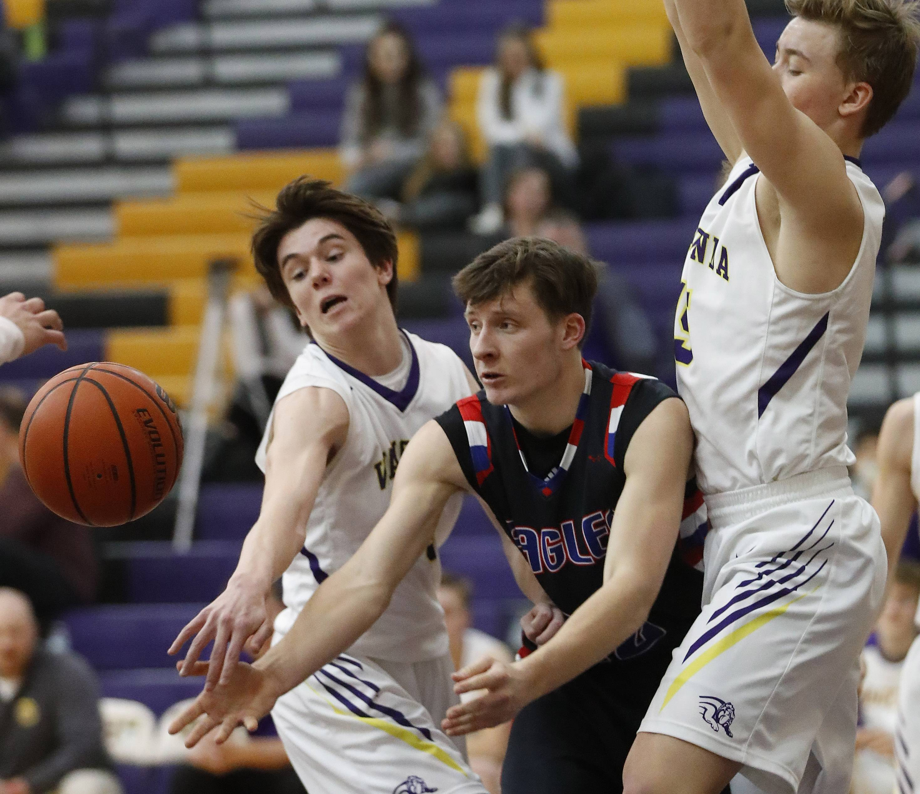 Lakes' Logan McCann, middle, passes the ball as Wauconda's Nicholas Bulgarelli, left, and Matthew Nolan defend on Tuesday night in Wauconda.