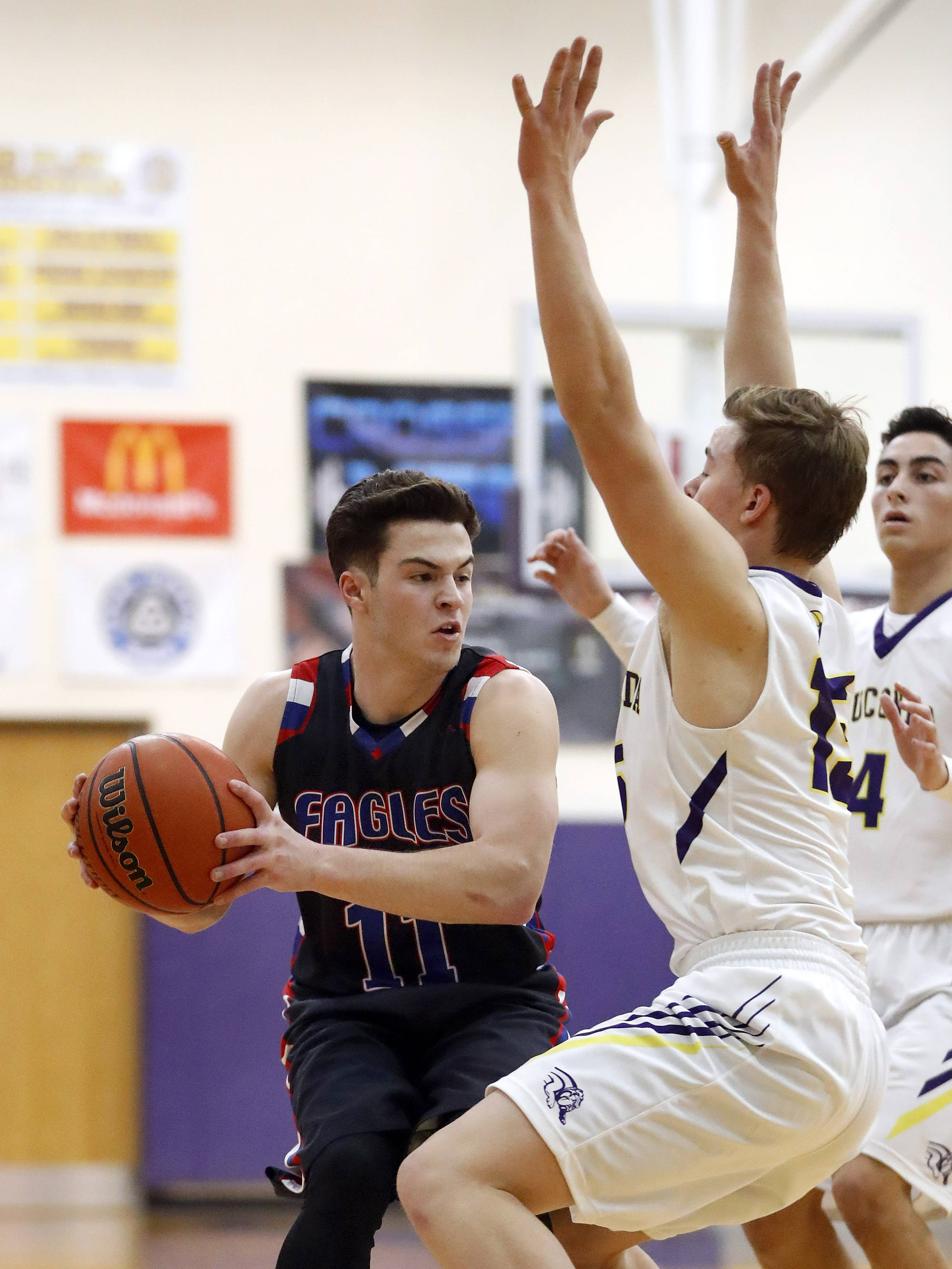 Lakes' Michael Behrendt, left, gets trapped by Wauconda's Matthew Nolan on Tuesday night in Wauconda.